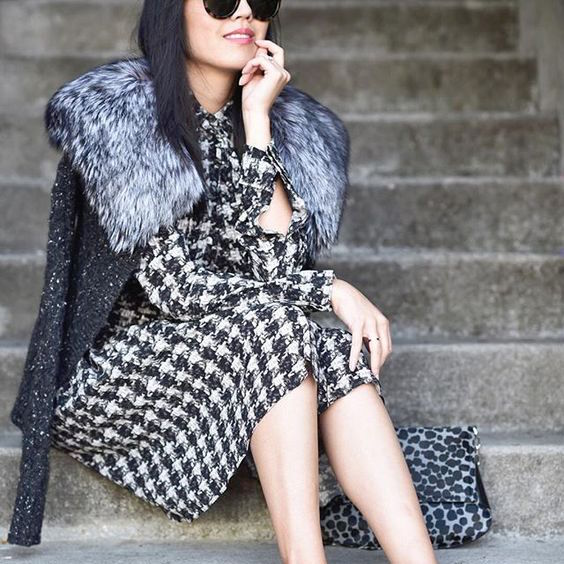 There is definitely something to be said for darker neutrals as a showcase for texture. What makes this so exciting is the range of color within the textures - the fur collar ranges from dark charcoal to almost white, the tweedy sweater has flecks of ivory, and the houndstooth dress provides even deeper contrast.  (Photo from   9to5Chic  )