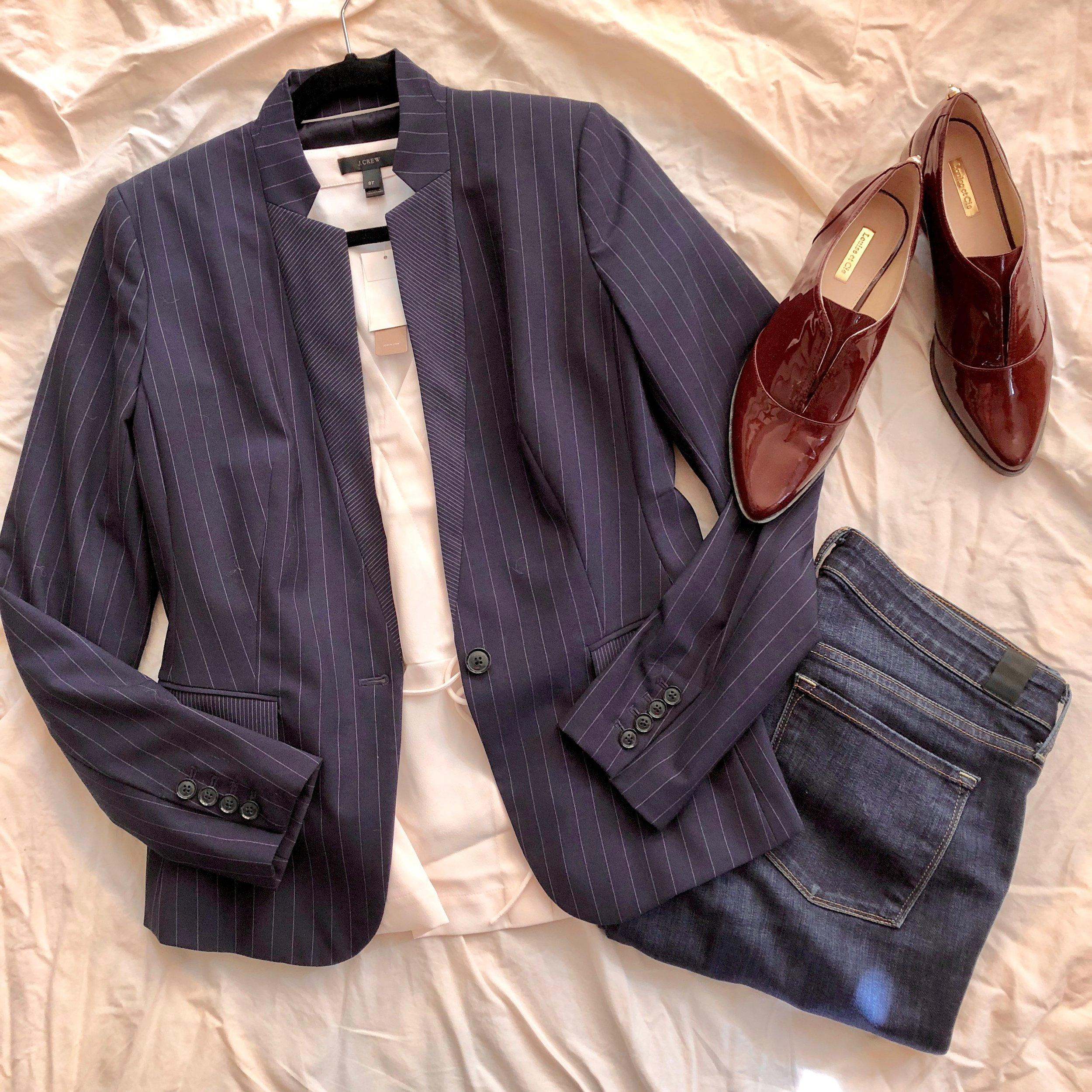 A tailored blazer is key in a business professional wardrobe, but it's also ideal for casual date night with washed out blue jeans and cute flats.