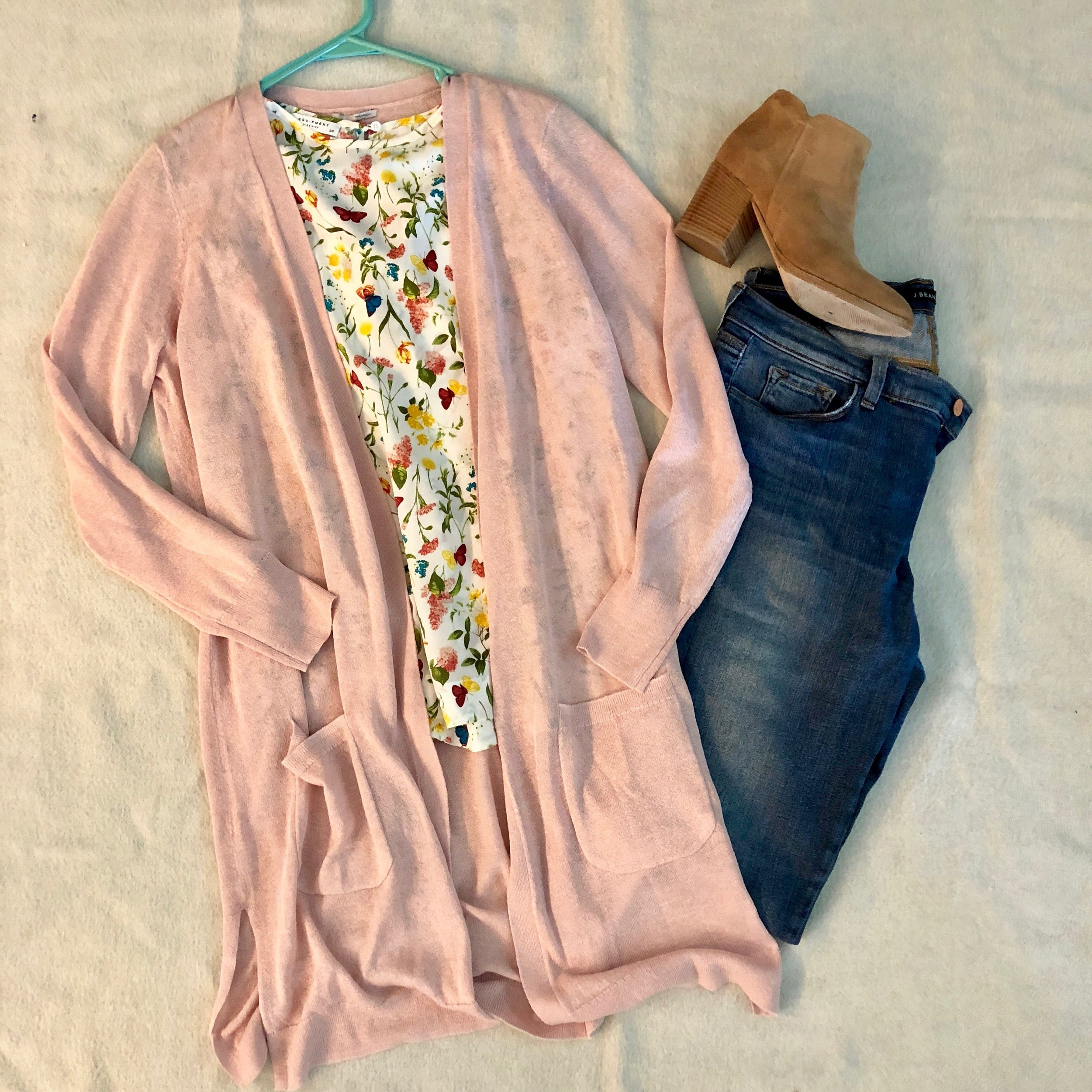 My client loves this floral print blouse, but planned on only wearing it to the office - so I showed her how to pair it with jeans and booties for a movie night with friends.