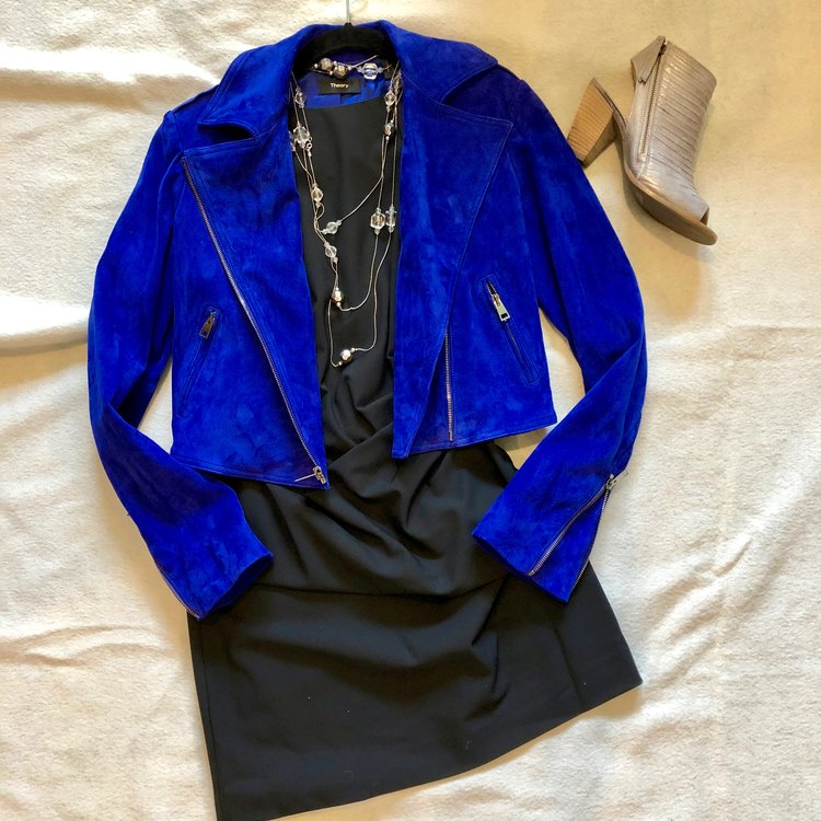 A classic little black dress isn't for cocktail parties only - add some edge with a cobalt moto jacket and open toe booties for girls' night out.