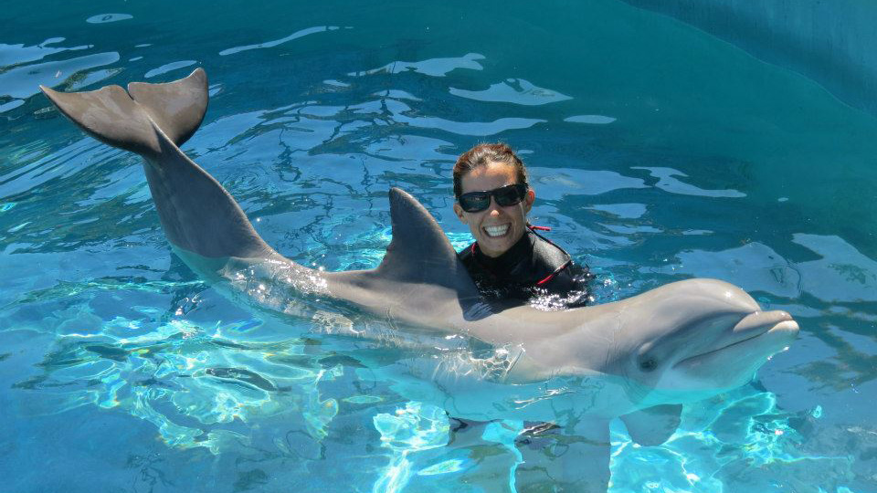 Jesse as a trainer at Sea Life Park with Adela