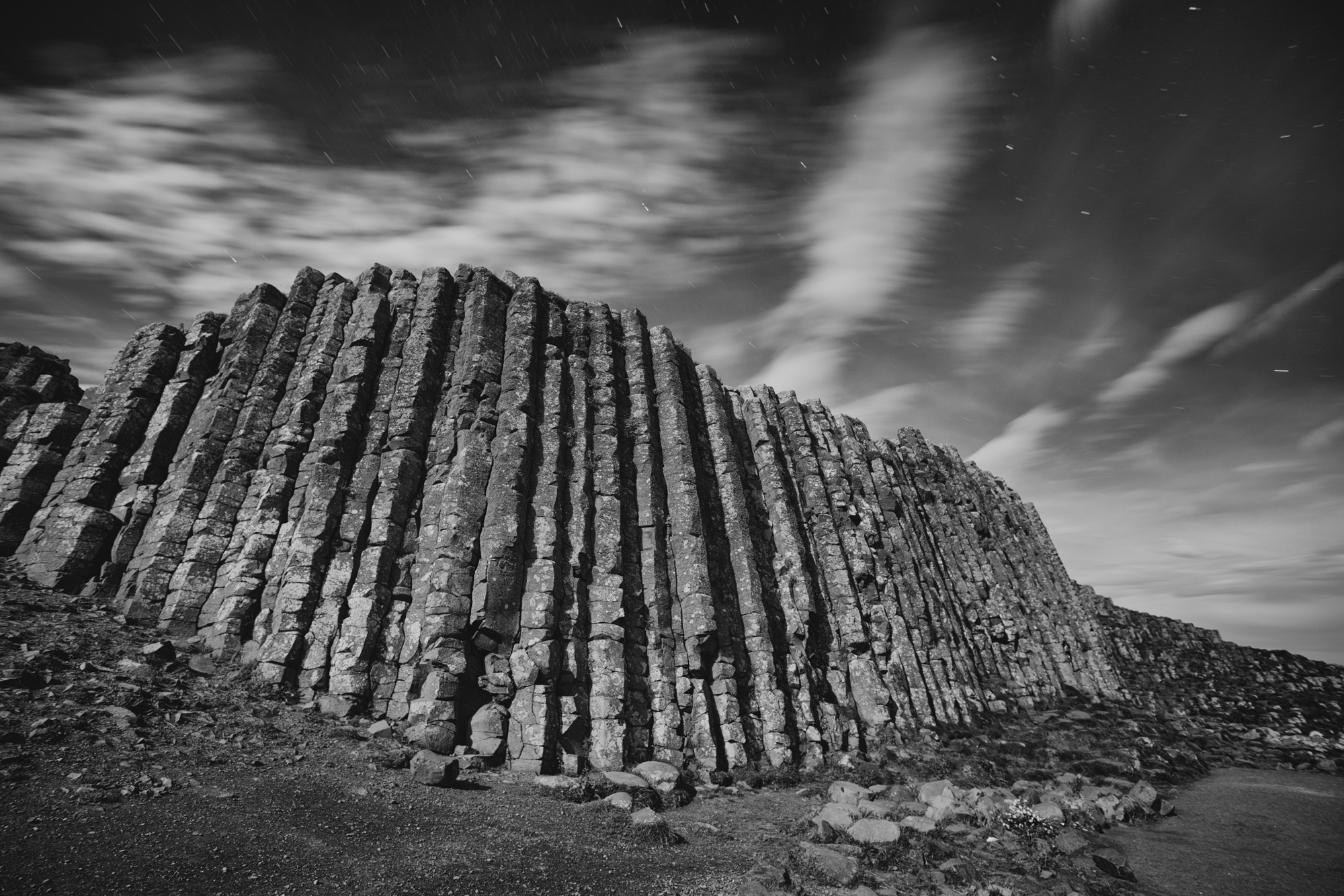 The unique basalt rock formation that comprise the Giants Causeway see from the side under strong moonlight.Prints available for purchase - contact  Matt@matthillart.com