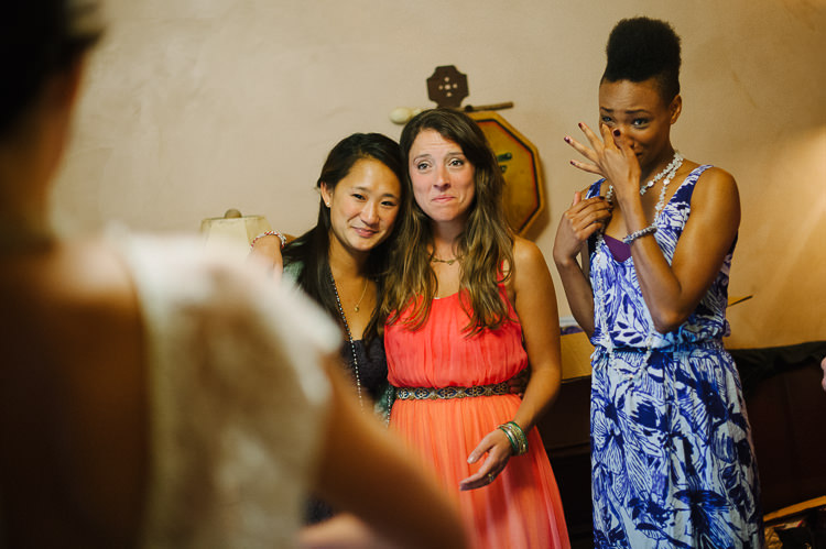 Best friends seeing her for the first time in her wedding dress!