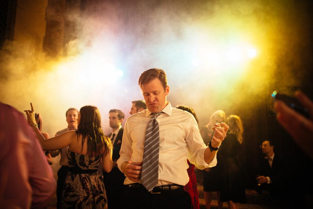 Wedding guest doing air guitar at Corinthian Ballroom San Jose