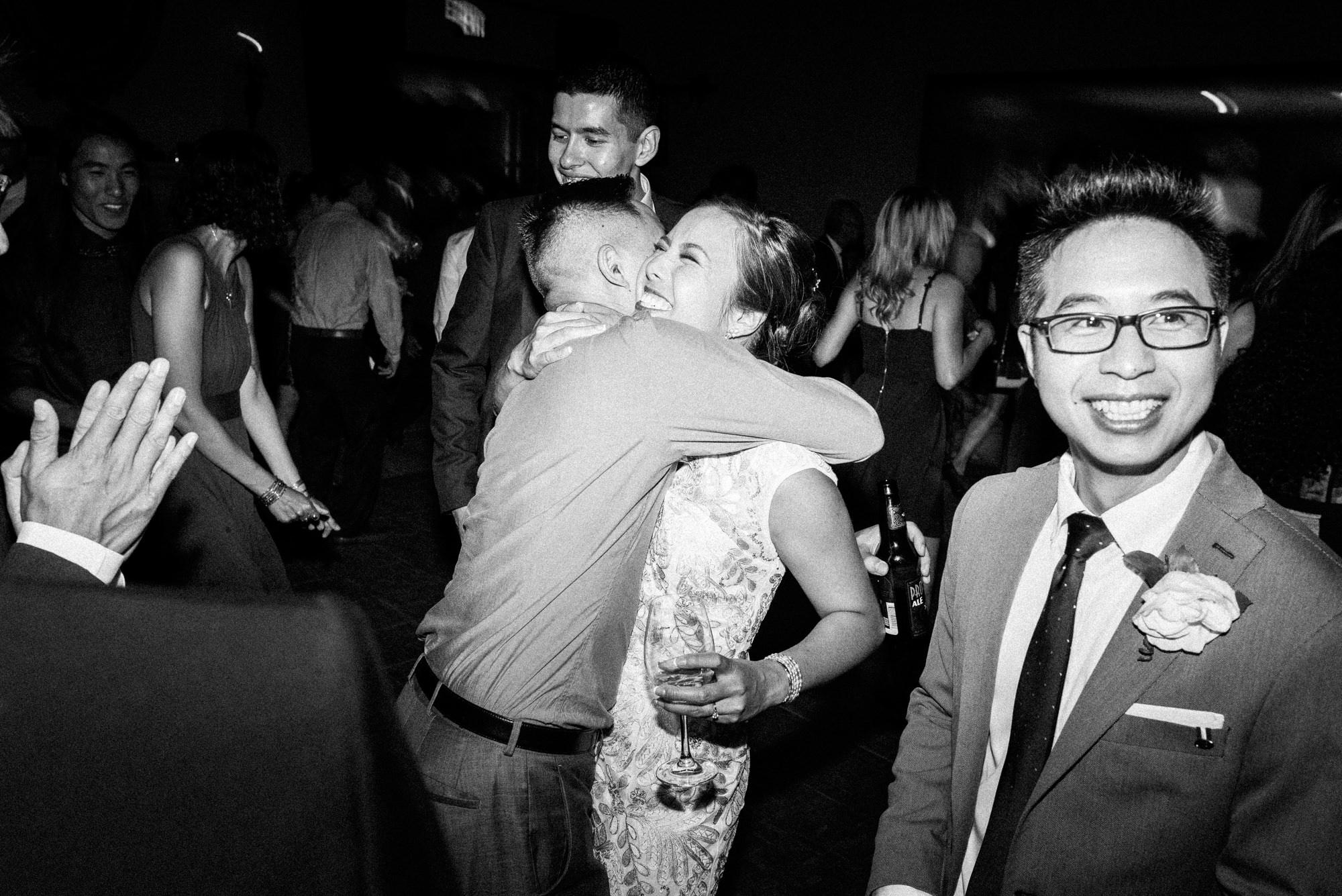 Bride hugging wedding guests at reception