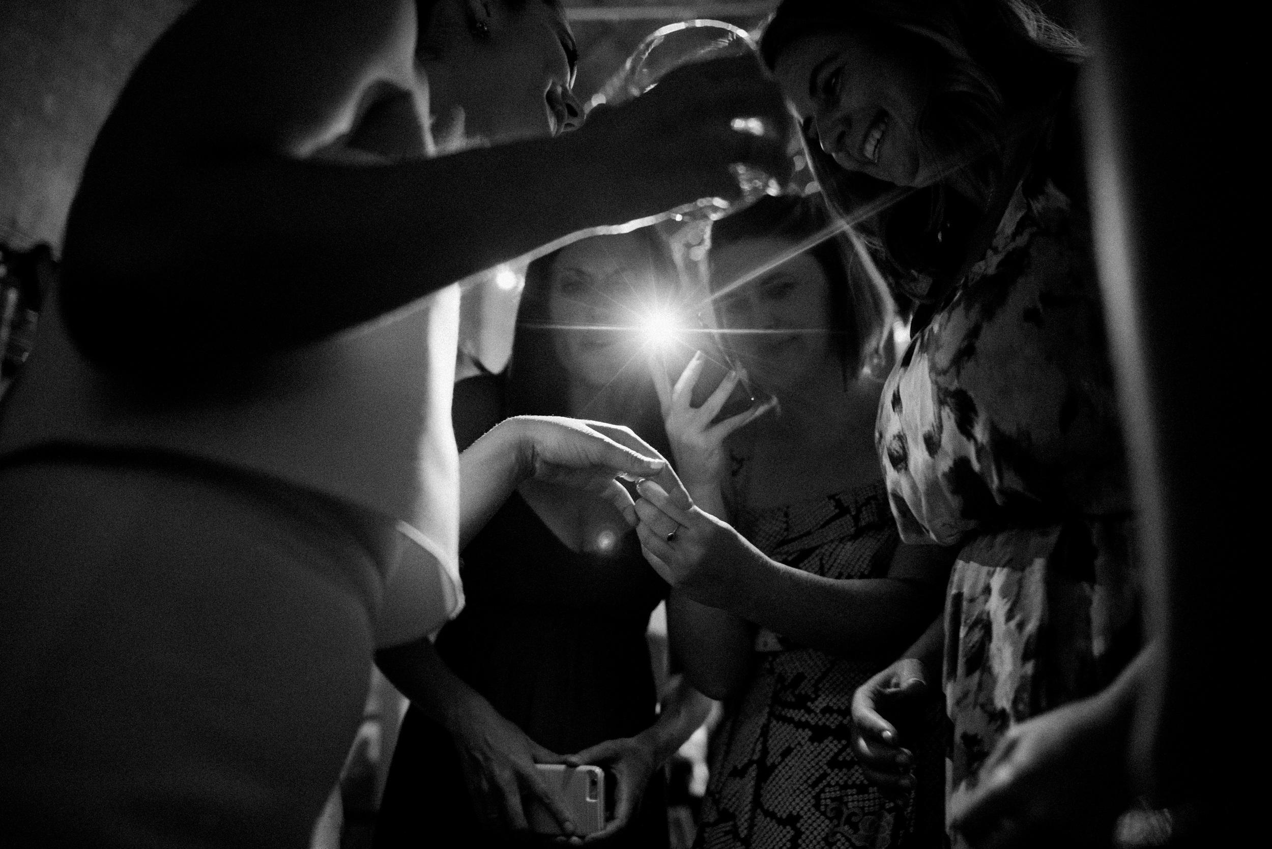 Women admiring bride's wedding ring