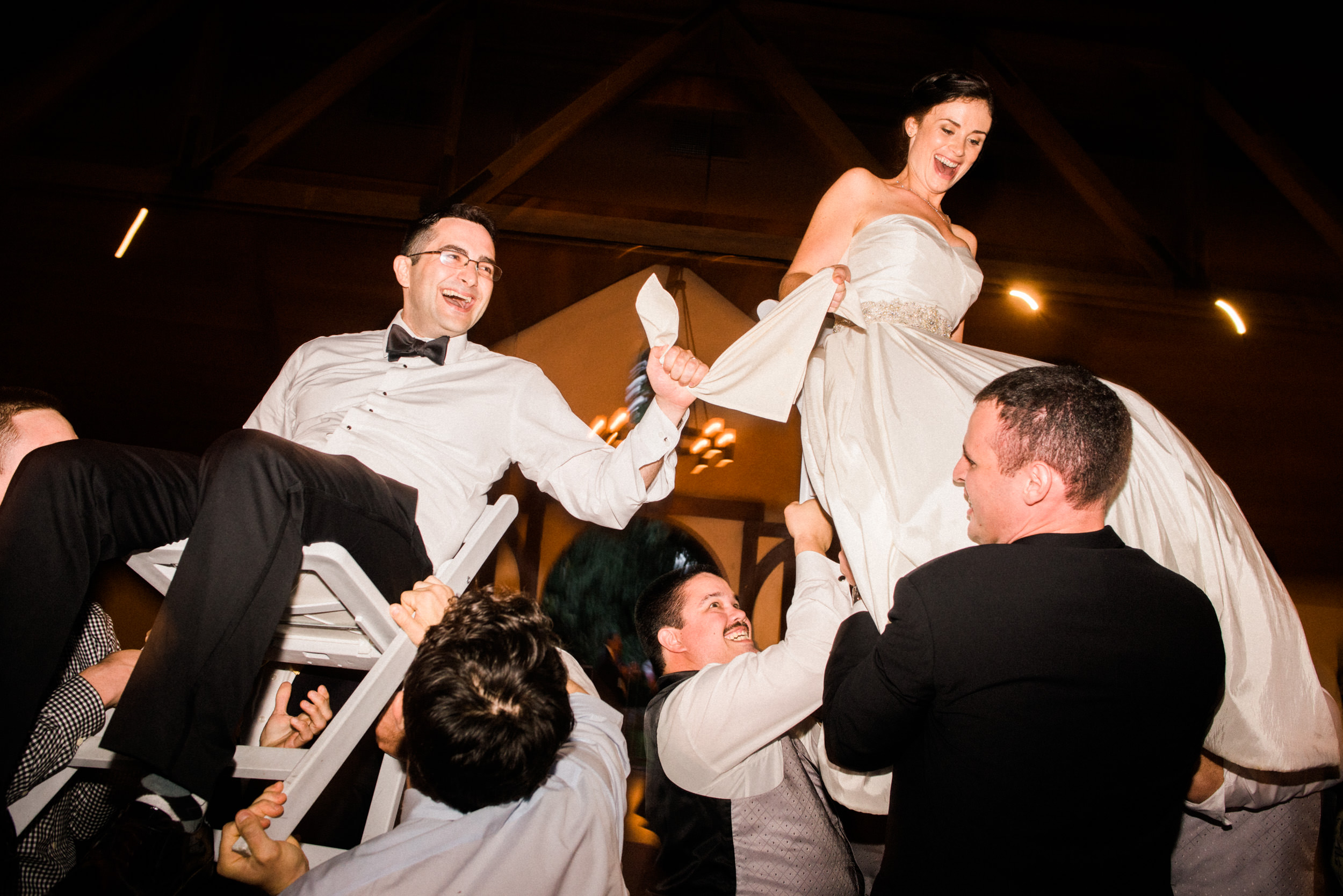 Bride and groom in traditional hora at Charles Krug Winery St. Helena