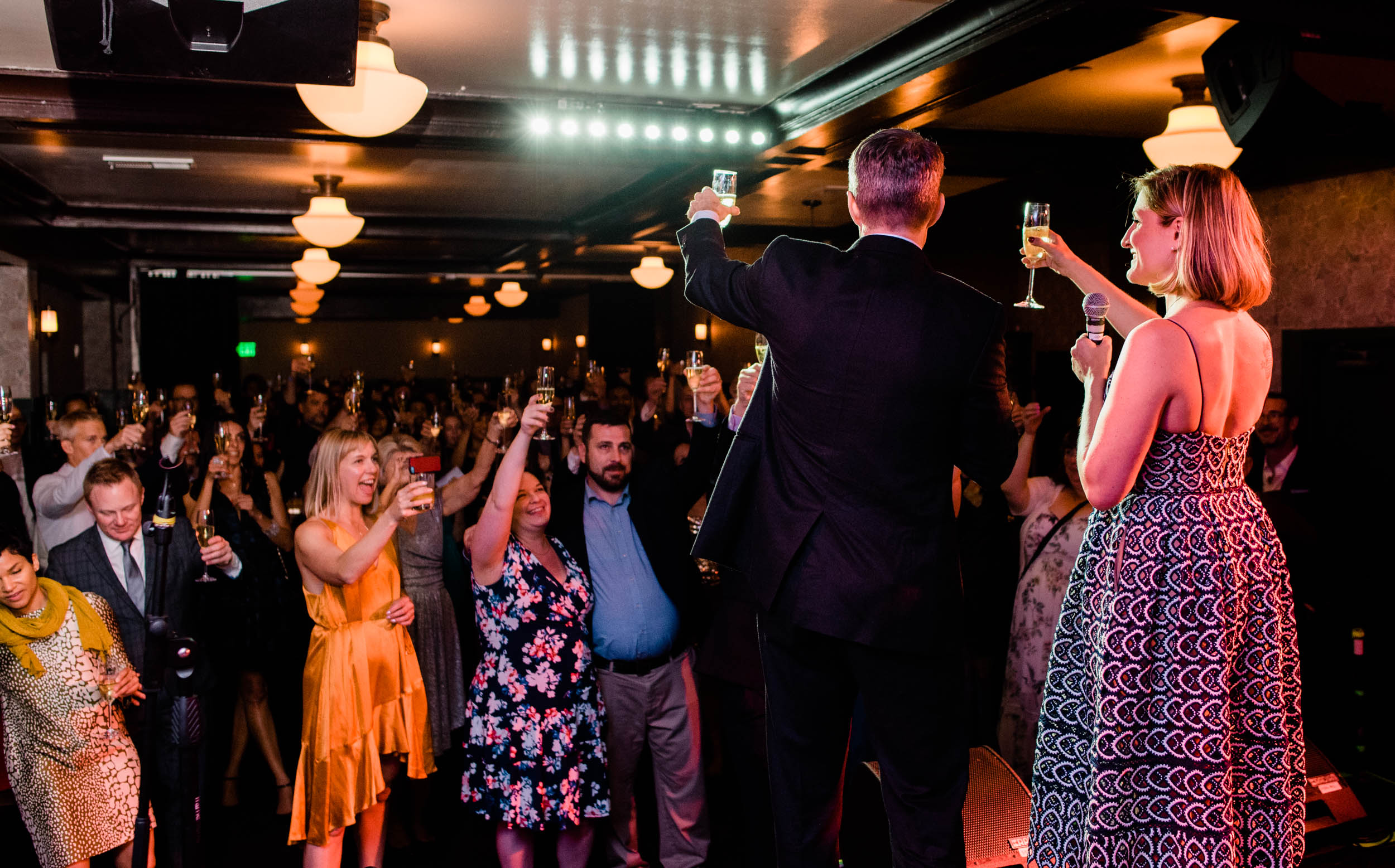 Bride and groom toast wedding guests at Cafe du Nord