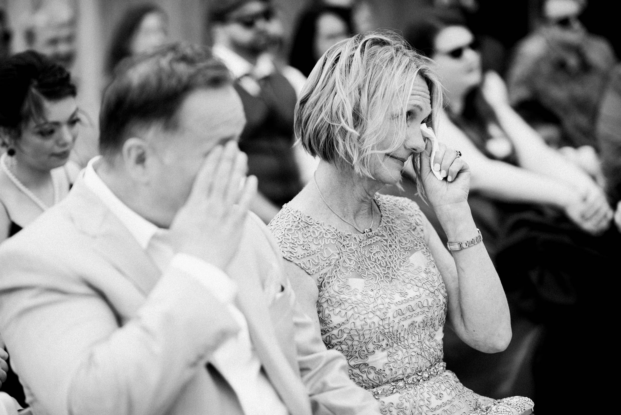 Parents of bride crying during wedding ceremony