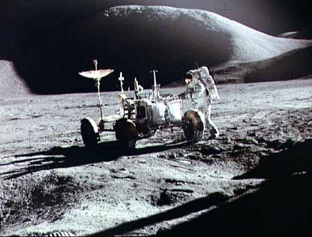 Astronaut Jim Irwin loads the first lunar rover on the Moon July 31, 1971.