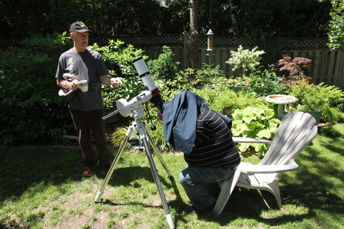 The centre's new solar telescope is checked out by Chris Maliicki and Gerard Foraie.