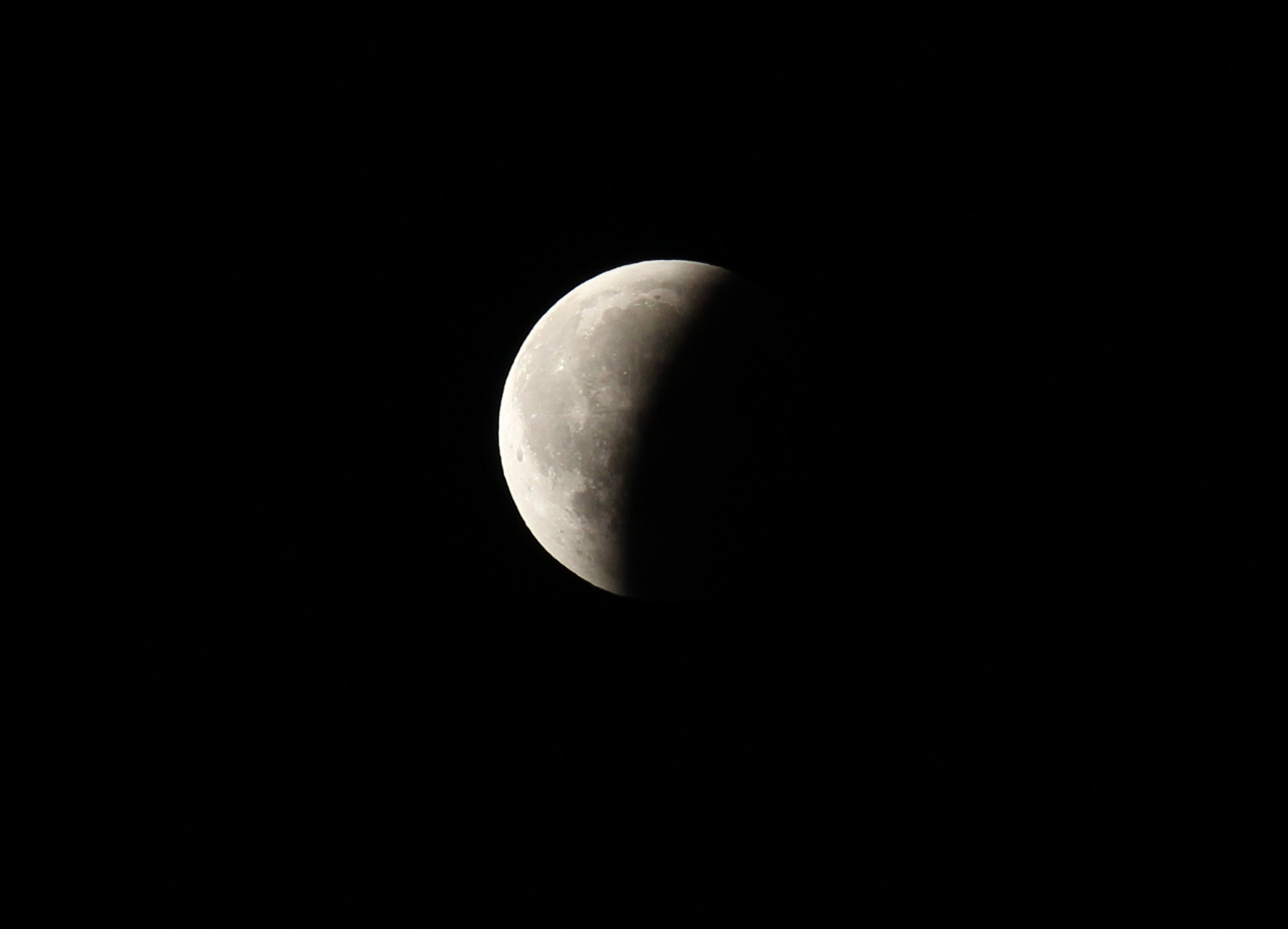 The Moon moves out of the Earth's shadow during an eclipse in 2010. Photo by Randy Attwood