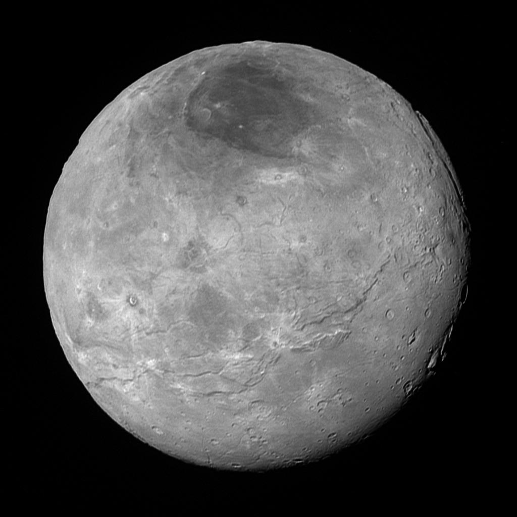 This image of Pluto's largest moon Charon, taken by NASA's New Horizons spacecraft 10 hours before its closest approach to Pluto on July 14, 2015 from a distance of 290,000 miles (470,000 kilometers), is a recently downlinked, much higher quality version of a Charon image released on July 15. Charon, which is 750 miles (1,200 kilometers) in diameter, displays a surprisingly complex geological history, including tectonic fracturing; relatively smooth, fractured plains in the lower right; several enigmatic mountains surrounded by sunken terrain features on the right side; and heavily cratered regions in the center and upper left portion of the disk. There are also complex reflectivity patterns on Charon's surface, including bright and dark crater rays, and the conspicuous dark north polar region at the top of the image. The smallest visible features are 2.9 miles 4.6 kilometers) in size.