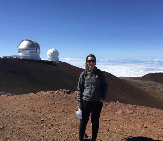 Dr Parker on top of Mauna Kea on the Big Island in Hawaii. Two telescopes partly funded by Canada (The Gemini-North Telescope and the Canada France Hawaii Telescope) can be seen behind me.