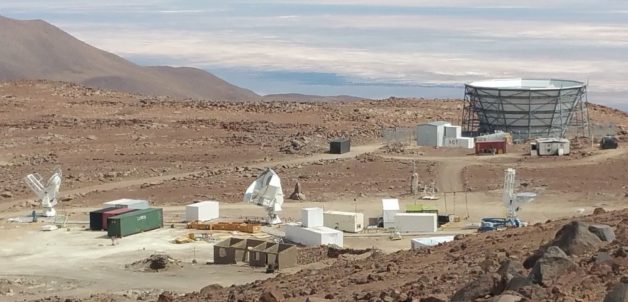 The Simons Array will be located in Chile's High Atacama Desert, at an elevation of about 17,000 feet. The site currently hosts the Atacama Cosmology Telescope (bowl-shaped structure at upper right) and the Simons Array (the three telescopes at bottom left, center and right). The Simons Observatory will merge these two experiments, add several new telescopes and set the stage for a next-generation experiment. (Credit: University of Pennsylvania)