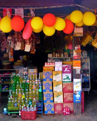 Local people set off fireworks to see the  New Year  in along the banks of the Mekong River in Phon Phisai.  We set off fire lanterns to drift high over the river into Lao.  This photo is of the family shop in the village stocked up ready for the celebrations