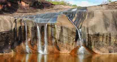 There are many   waterfalls   to visit but as we are open during the dry season the flow tends to be low.  However the surrounding countryside is wild and magnificent. We travel to some waterfalls by boat through the jungle