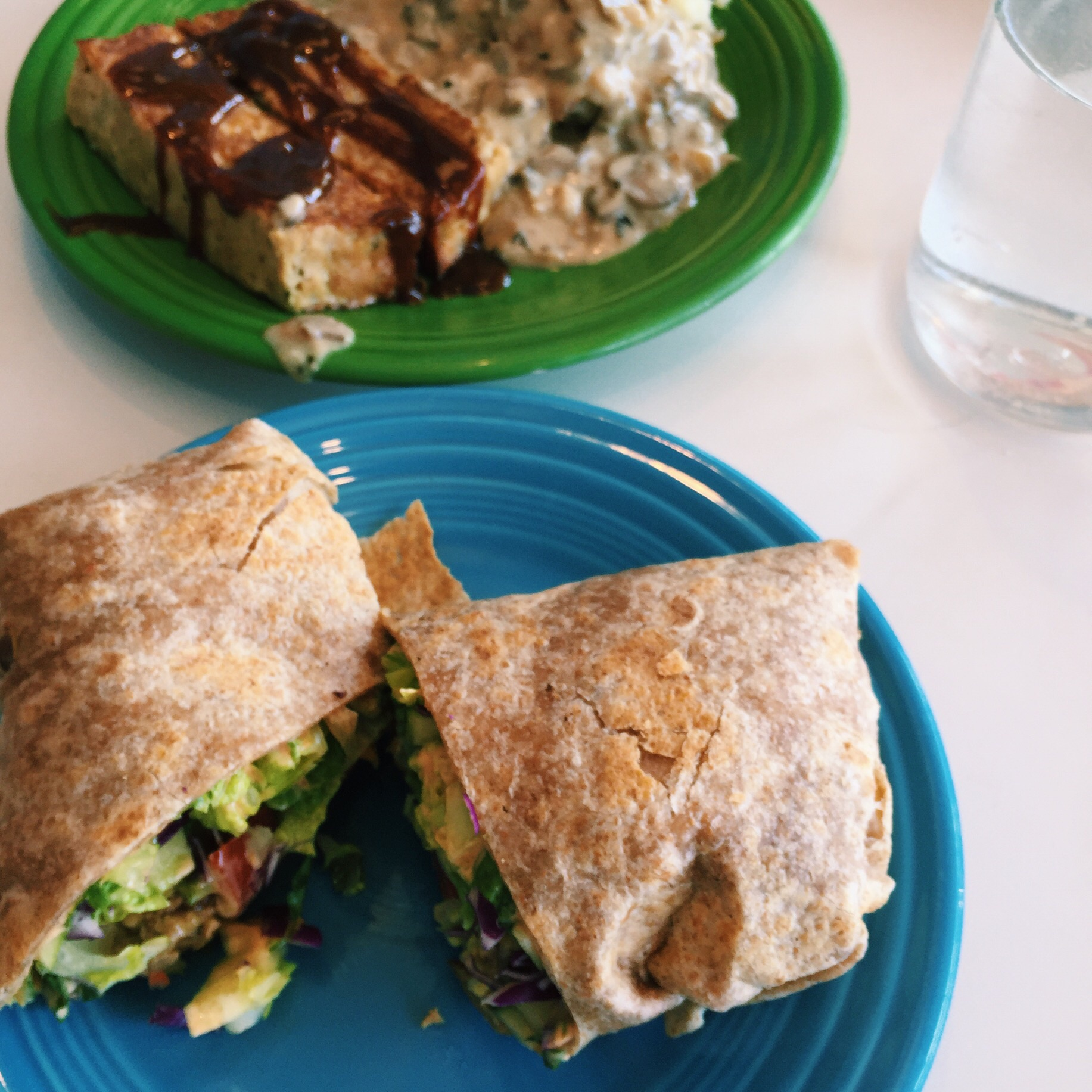 Bbq tempeh wrap and 'neat' loaf with mashed potatoes and mushroom gravy from Silence Heart Nest in Seattle.