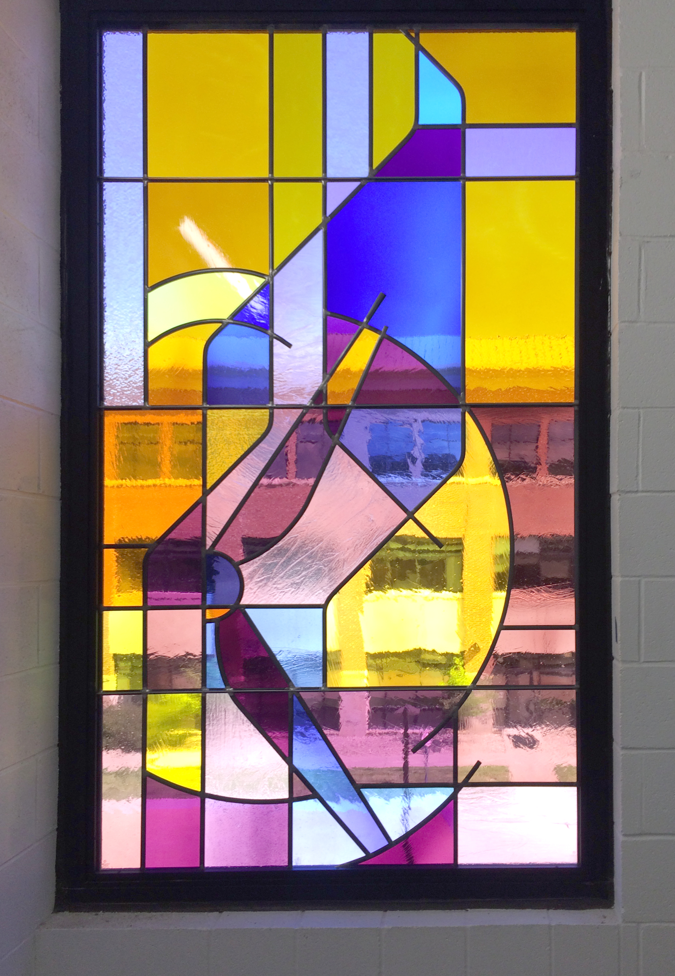 Stained glass in the stairwells by Creative Stained Glass Studio.