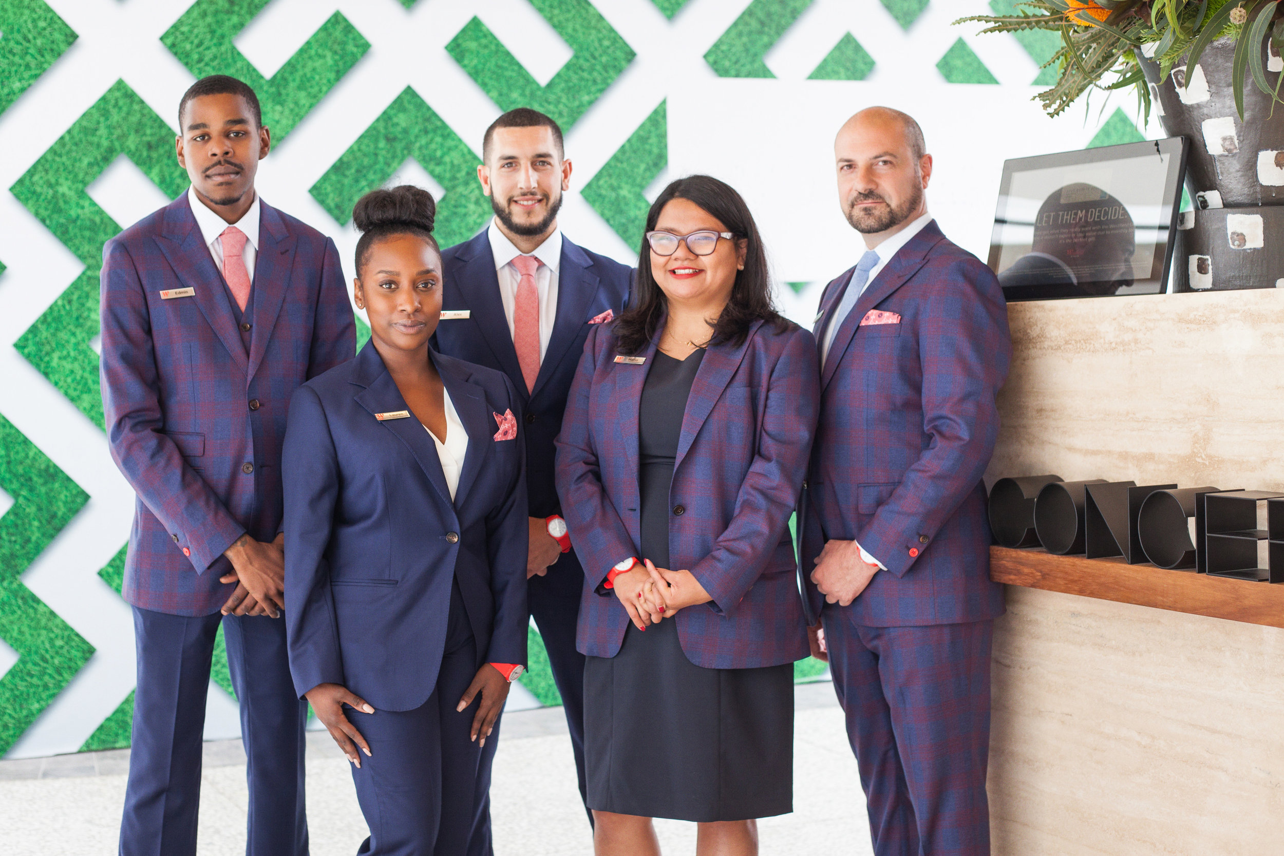 Westfield Century City Concierge team in custom suiting. Red accents play to iconic brand color
