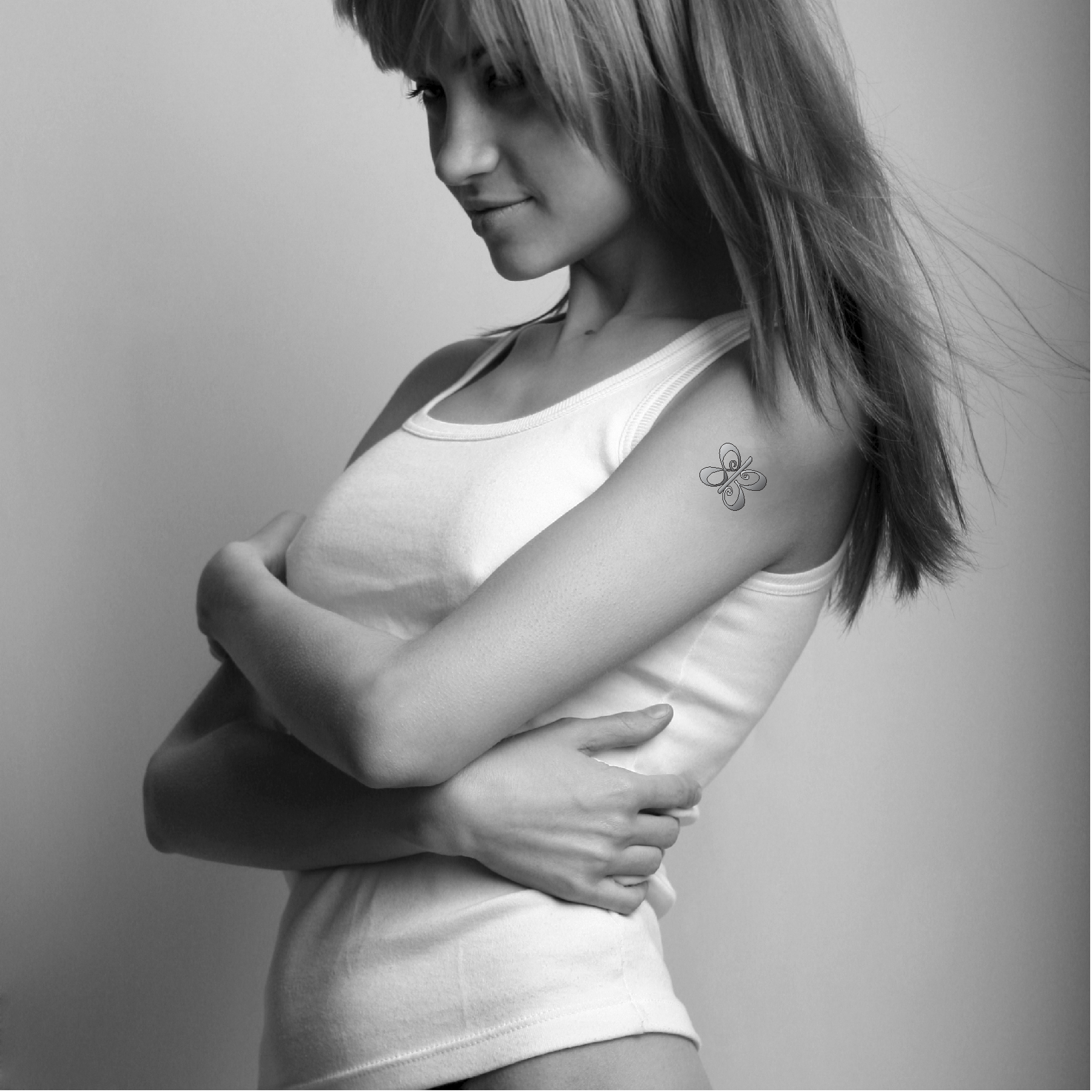 Girl w Bfly Tattoo.png