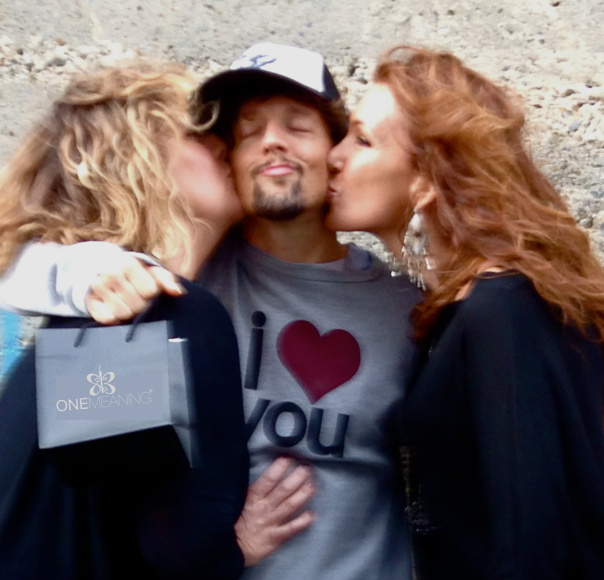 Ingrid and Karen of One Meaning with Jason Mraz in between.
