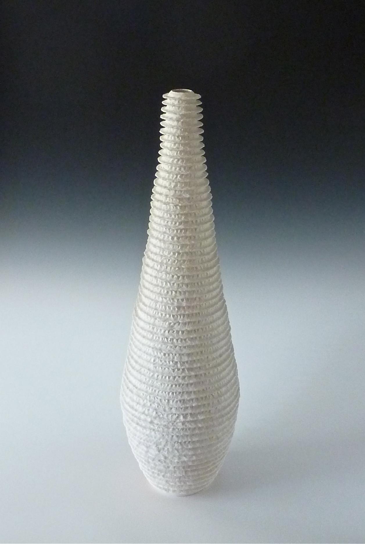 White ribbed teardrop vessel