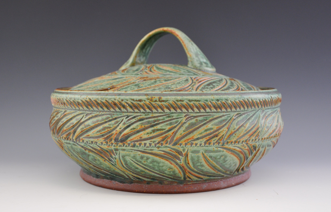"Green Casserole  ceramic approx 6 1/2"" high x 11"" diameter"