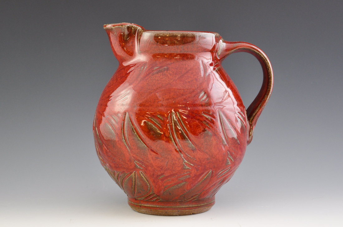 "Red Pitcher  ceramic approc 7 1/2"" tall x 6 1/2"" wide"