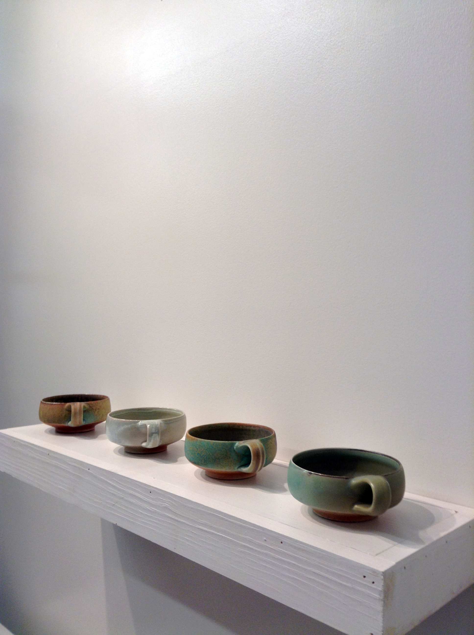 Low handled cups by  Tyler Gulden