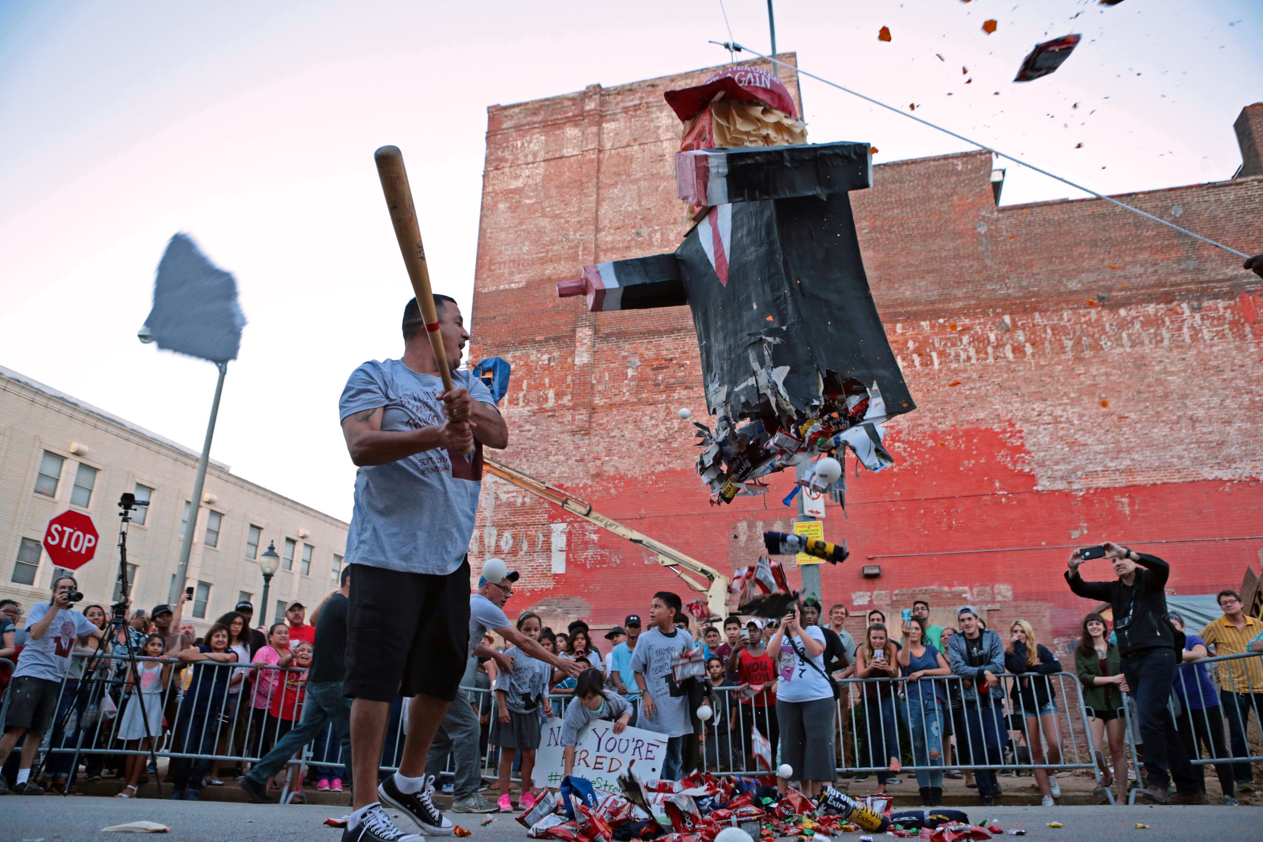 Roberto Estrada, 39, of St. Louis, hits the Donald Trump piñata at Viva Mexico on Cherokee Street in St. Louis, celebrating Mexico's Independence Day, on Sunday, Sept. 18, 2016.