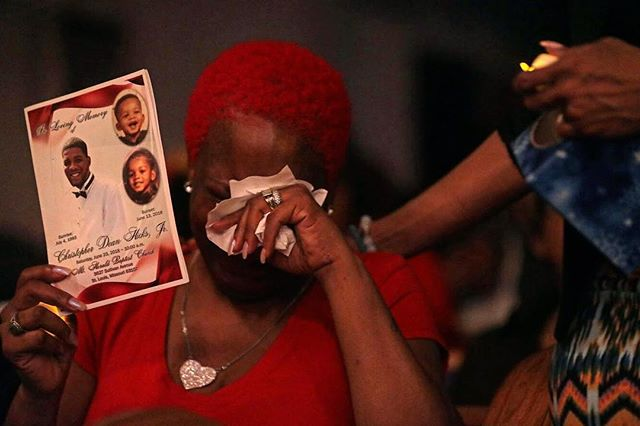 "Shantae McGrew holds up a program from her son's funeral during a vigil remembering the St. Louis area victims of homicide in 2018 at Williams Temple Church of God in Christ in St. Louis on Monday, Dec. 31, 2018. ""Today is my birthday,"" cried McGrew as a woman rushed over to comfort her. ""This is the first birthday without my baby."" #photojournalism #onassignment #stltoday #stl"