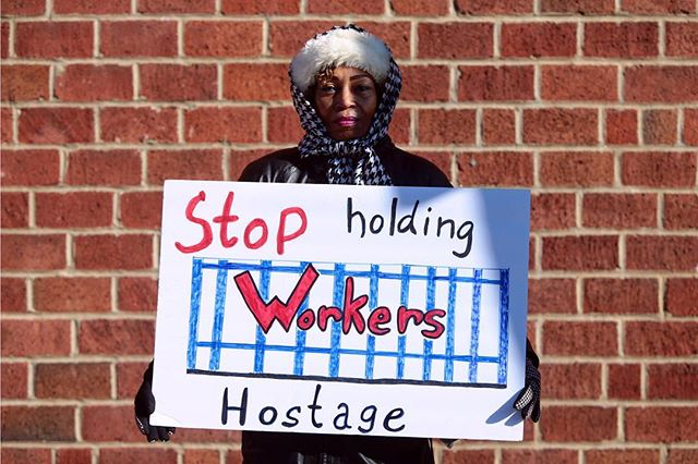 Federal worker Pamela Robinson poses for a portrait after a rally against the government shutdown outside of Congressman Lacy Clay's south St. Louis office on Friday, Jan. 25, 2019, as the shutdown entered its 35th day. Shortly after, President Trump announced a deal to reopen the government for three weeks as negotiations continue over a proposed wall at the U.S.-Mexico border. Photo by Cristina M. Fletes, cfletes@post-dispatch.com. #stltoday #stl #governmentshutdown #onassignment #makeportraits