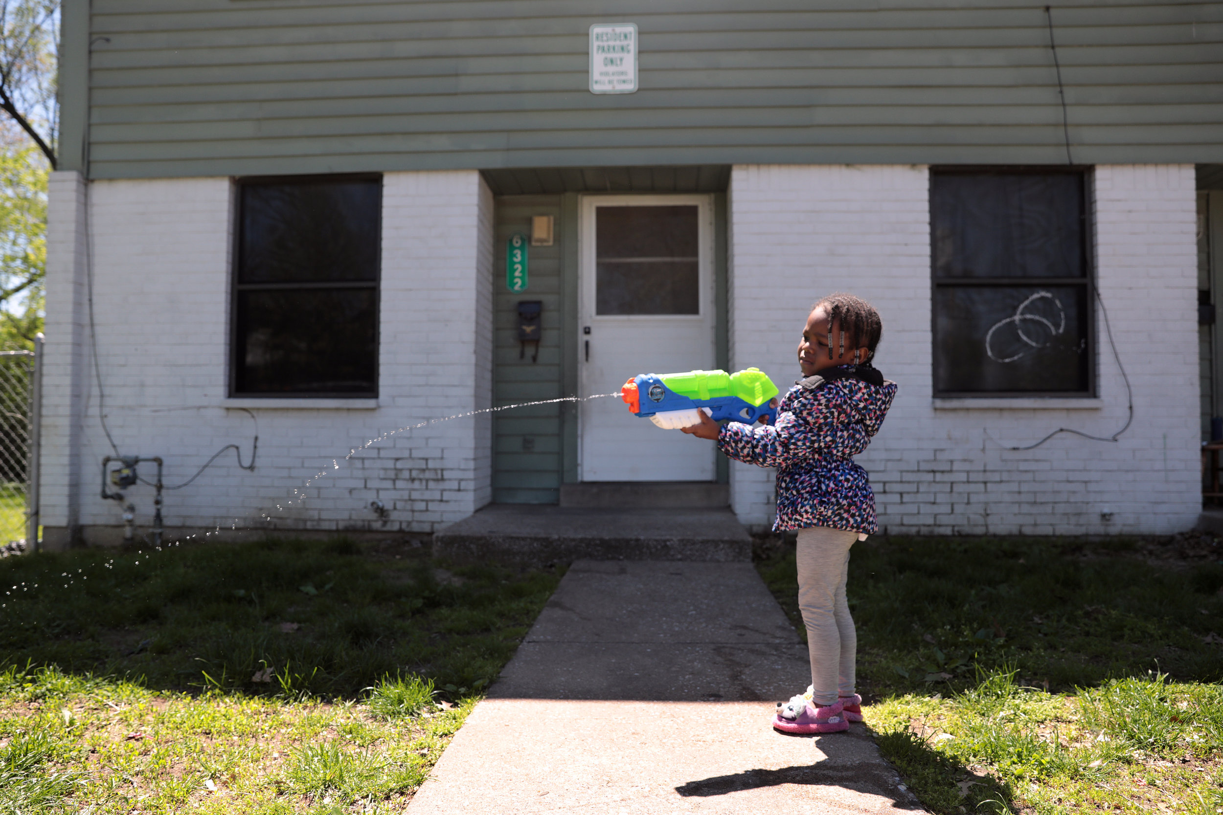 Rylie Vickers, 3, plays outside her apartment complex on Isabella Avenue in Wellston on Friday, April 26, 2019. The U.S. Department of Housing and Urban Development is looking to demolish or get rid of 201 public housing units in Wellston, which could affect the apartment complex and many others in the area.