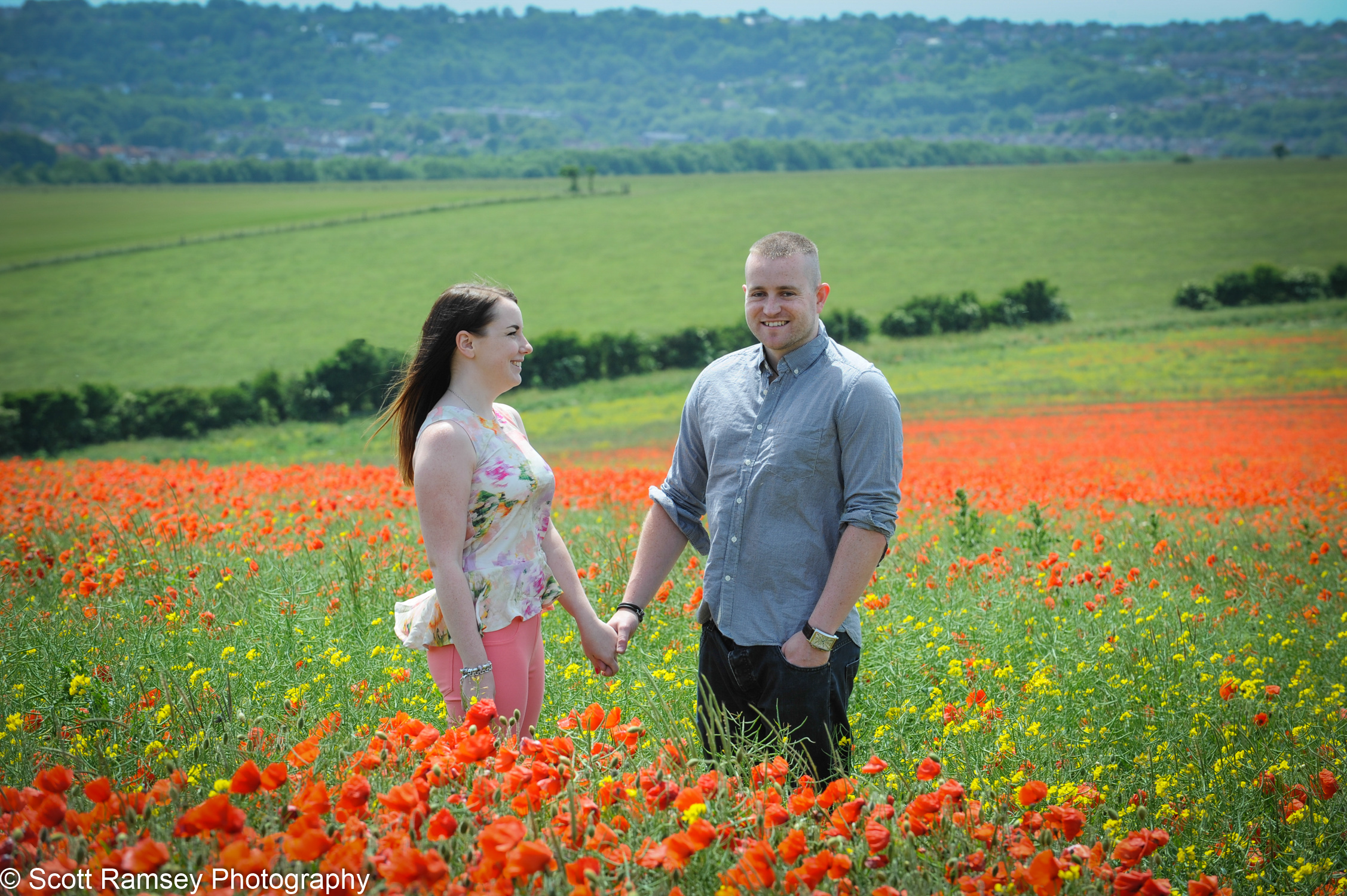 Holding Hands Couple In Poppy Field Sussex