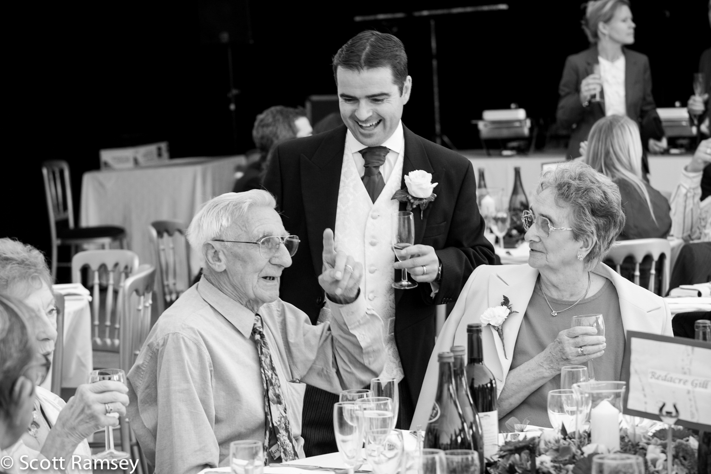Groom Talks To Wedding Guests