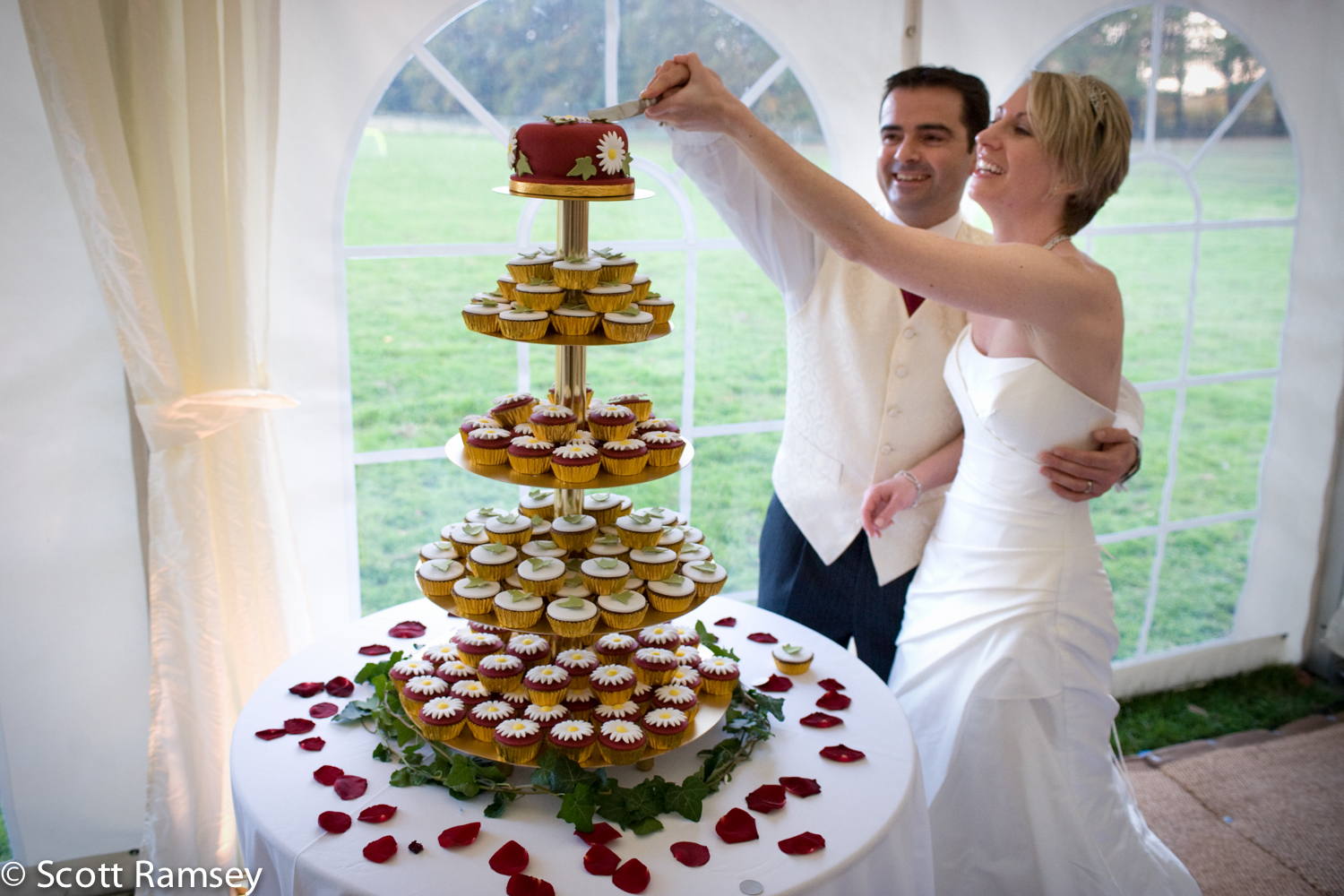 Bride And Groom Cake Cutting Surrey