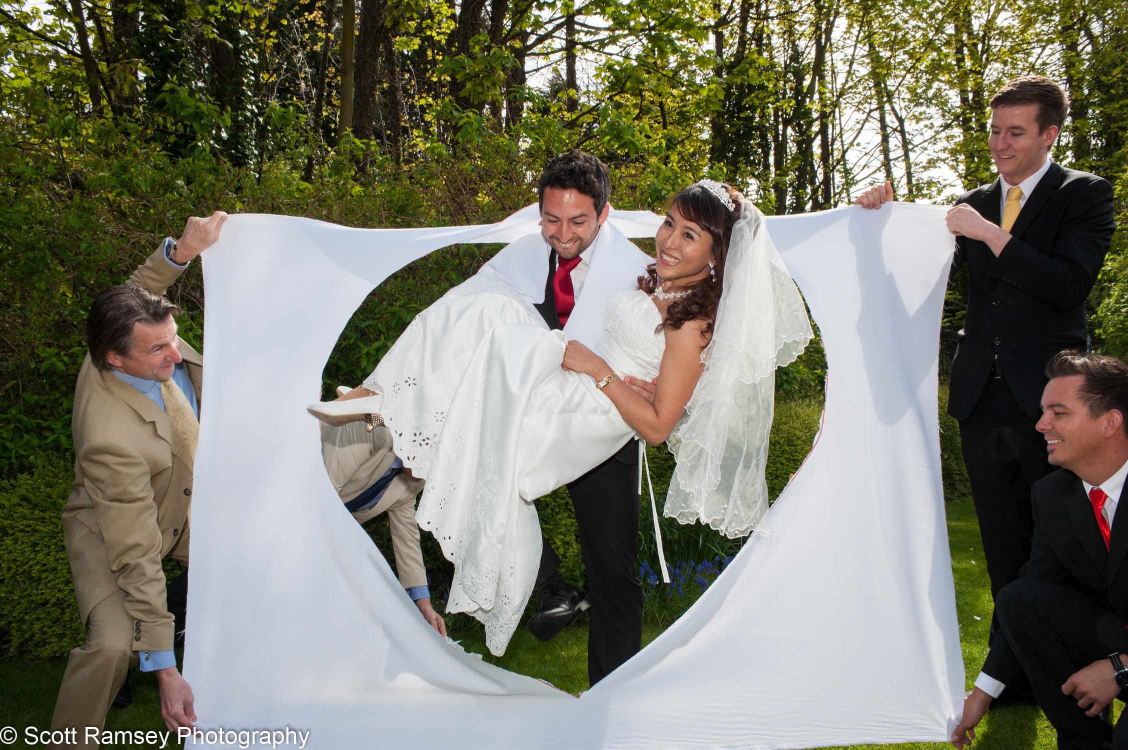 Portsmouth Registry Office Wedding Groom Carries Bride 040513-31