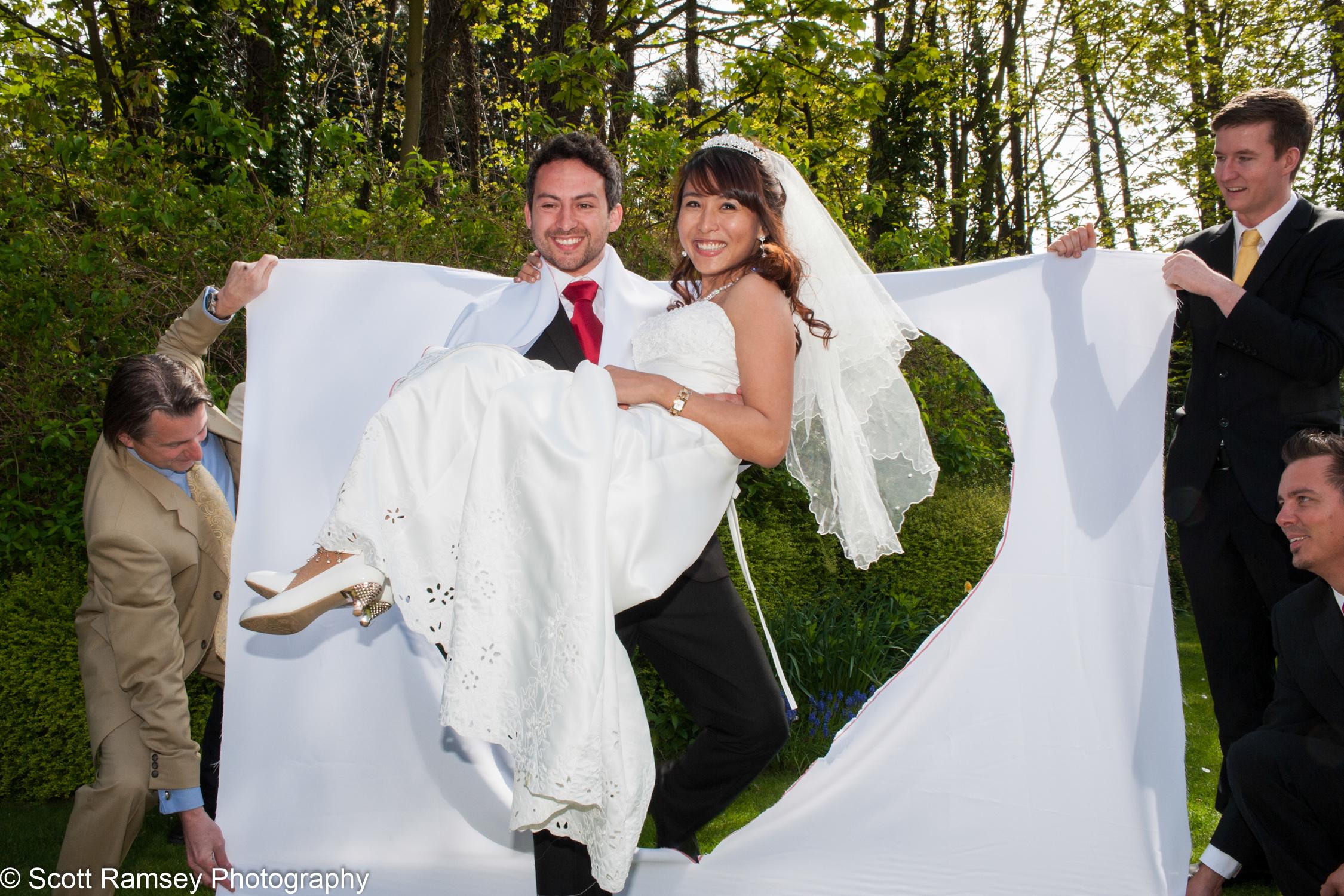 Portsmouth Registry Office Wedding Groom Carries Bride 040513-32