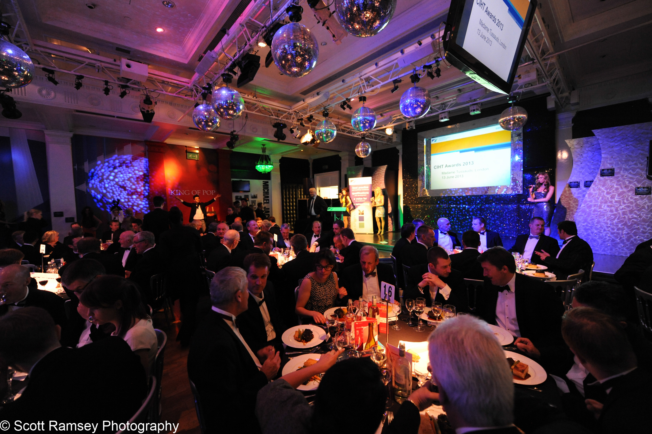 Guests enjoy an awards dinner in theWorld Stage Ballroomat Madame Tussauds in London.