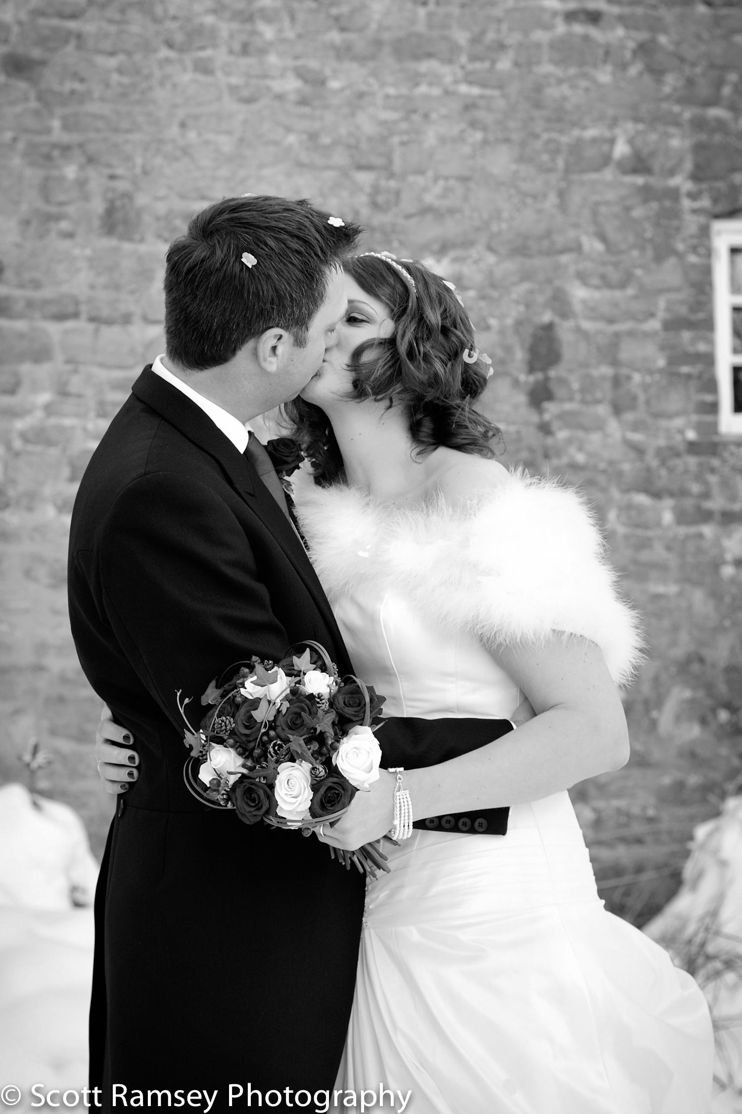 Winter-Wedding-Spread-Eagle-Hotel-Midhurst-Bride-Groom-Kiss-In-S
