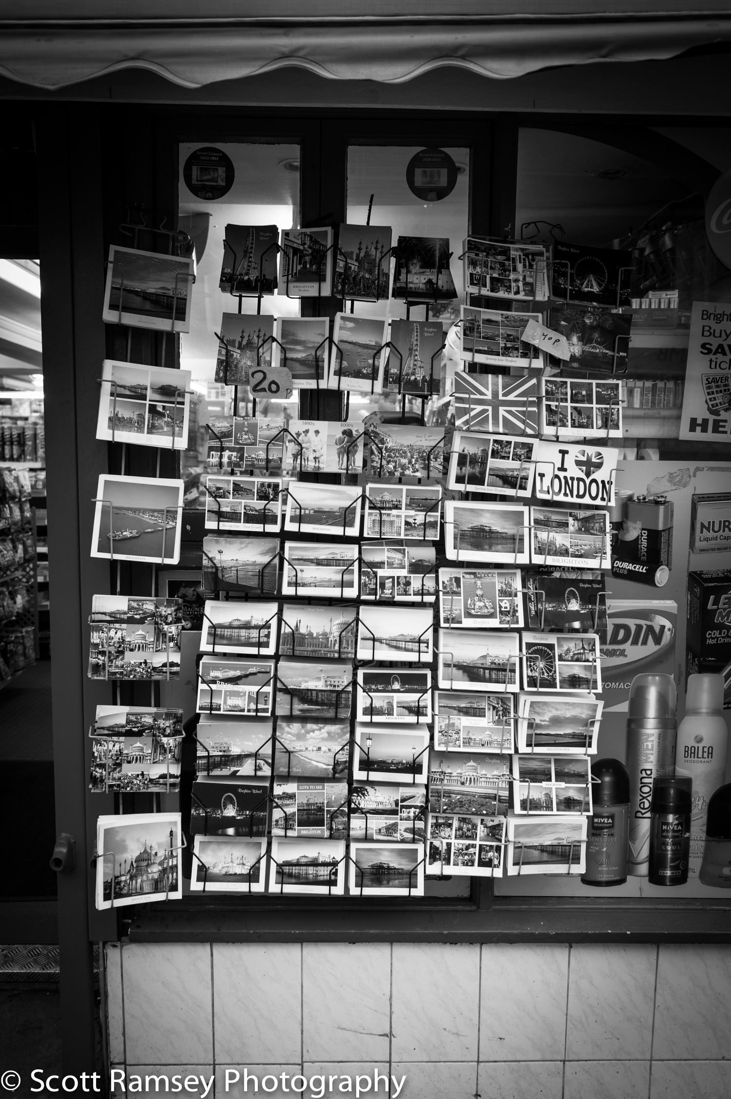 Postcards for sale outside a shop in Brighton, East Sussex.