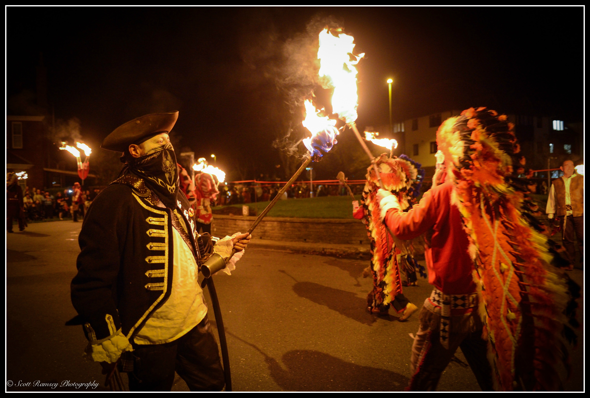 A member of the Eastbourne Bonfire Society holds a lit torch during the Littlehampton Bonfire Grand Torchlight Procession.
