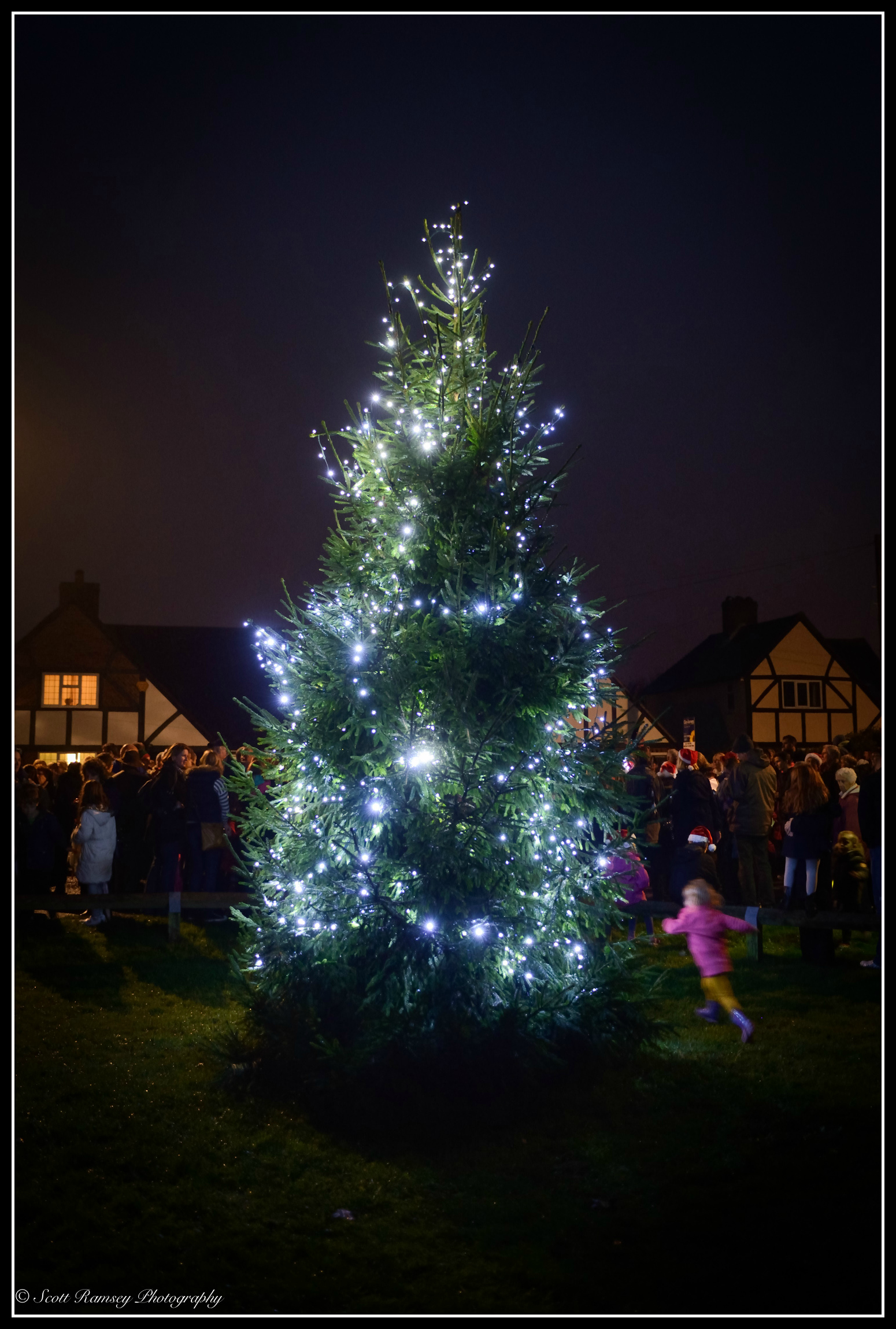 A child runs past the East PrestonChristmas tree lights during theswitch on event in the West Sussex village.