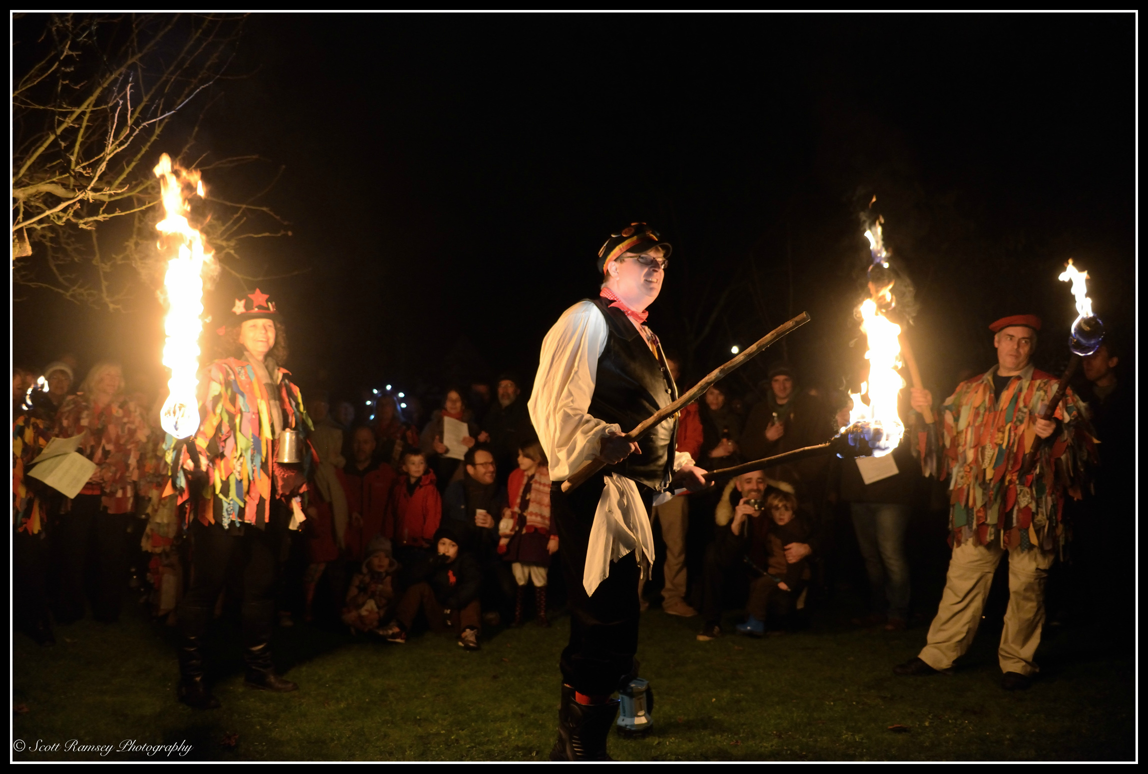 By the light of flaming torches the Wassail takes place in an apple orchard in Tarring, West Sussex.