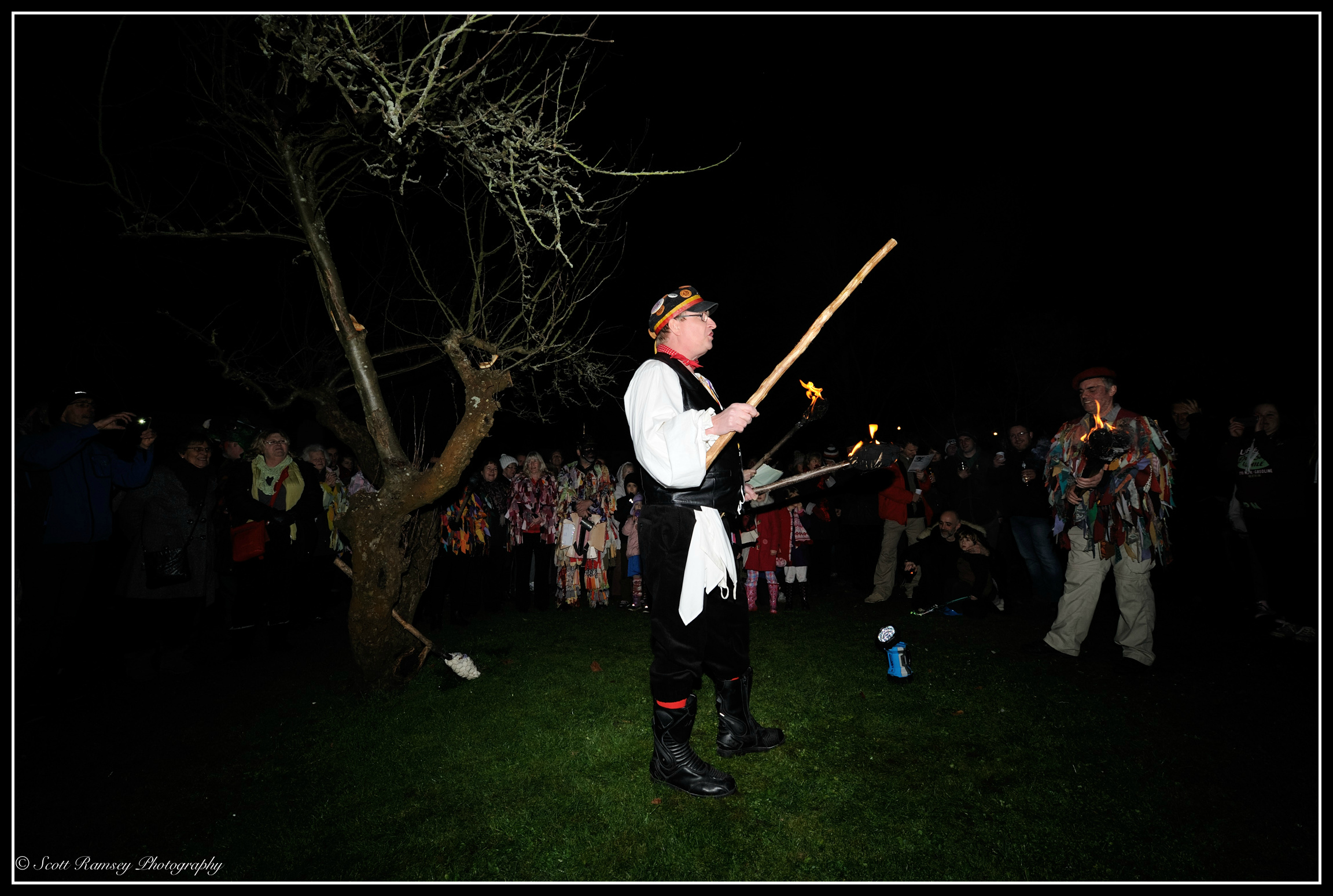 A member of the Sompting Village Morris leads the chanting during the Wassail in an apple orchard at Tarring village in West Sussex.