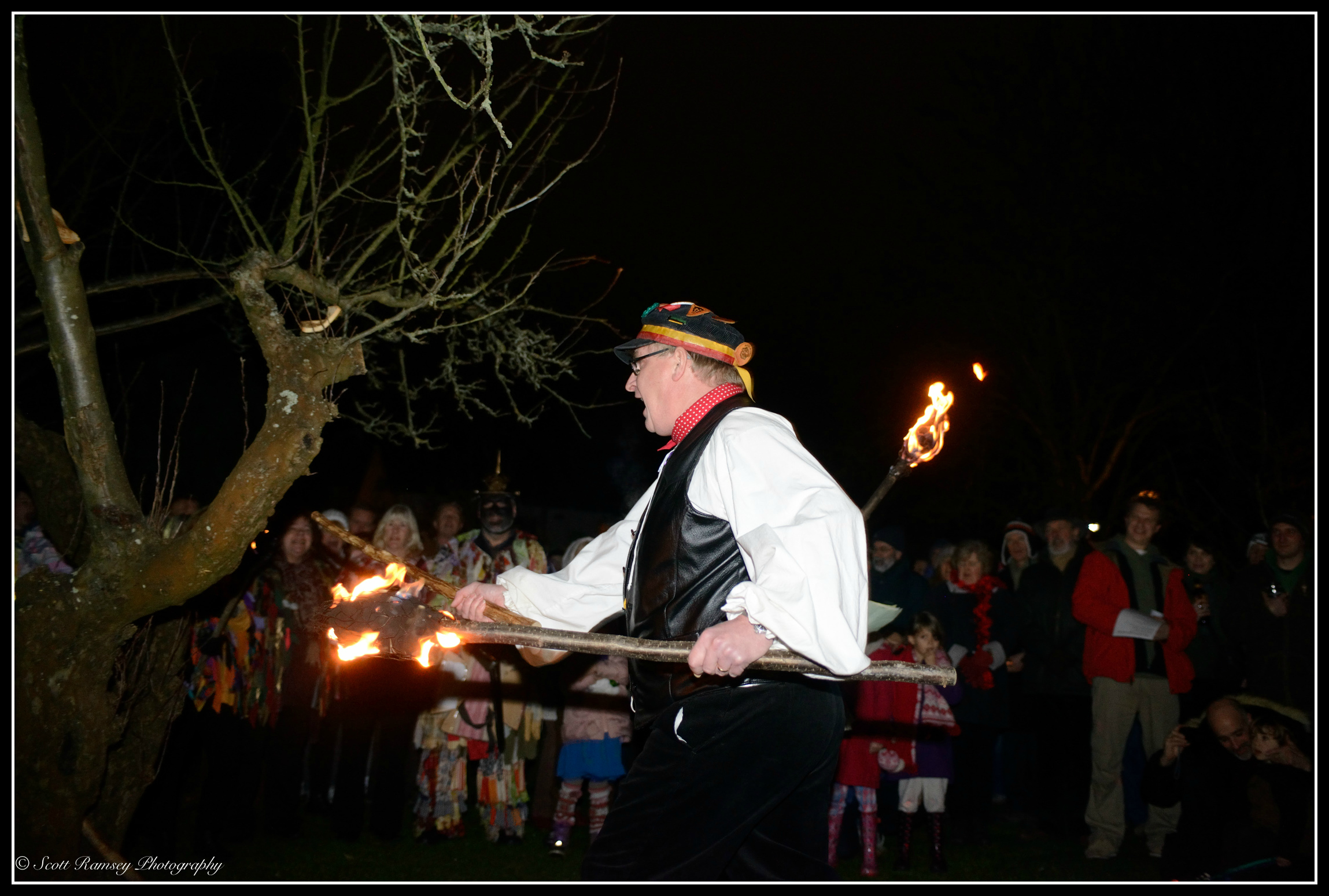 During the Wassail at Tarring village in West Sussex a stick is hit against an apple tree and achant shouted. The idea is to make as much noise as possible to awaken the tree spirits.