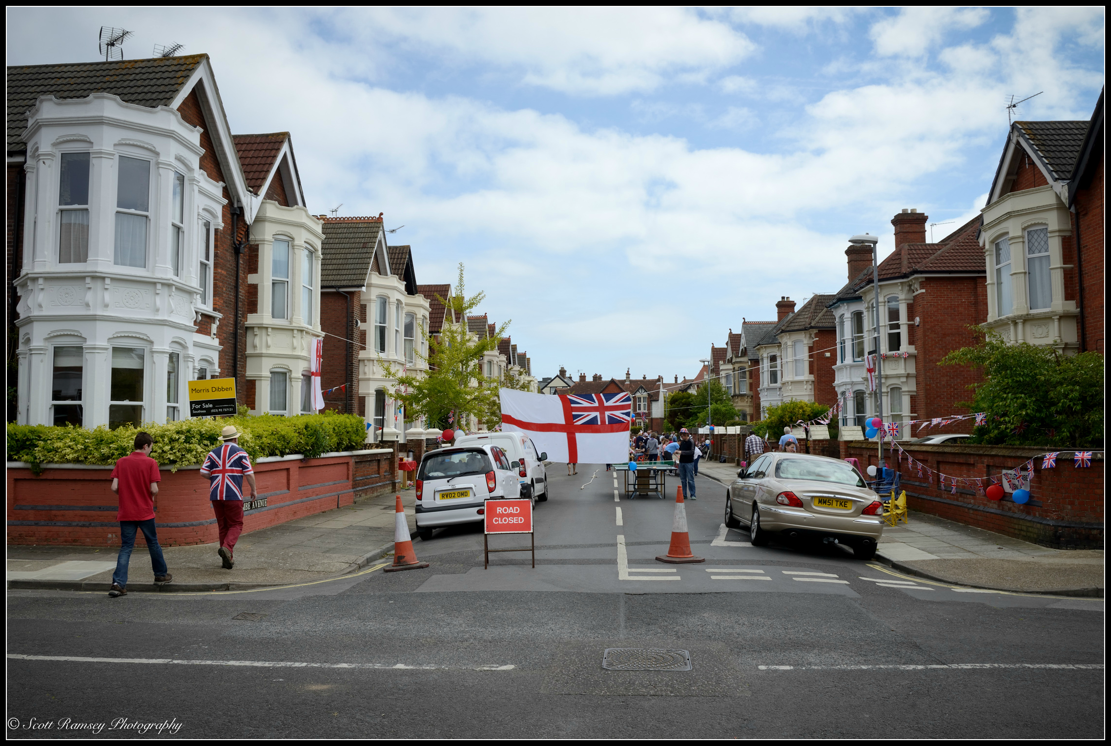 Residents from nearby streets arrive for the VE Day street party in  Nettlecombe Avenue , Southsea, Portsmouth., UK. © Scott Ramsey Photography.