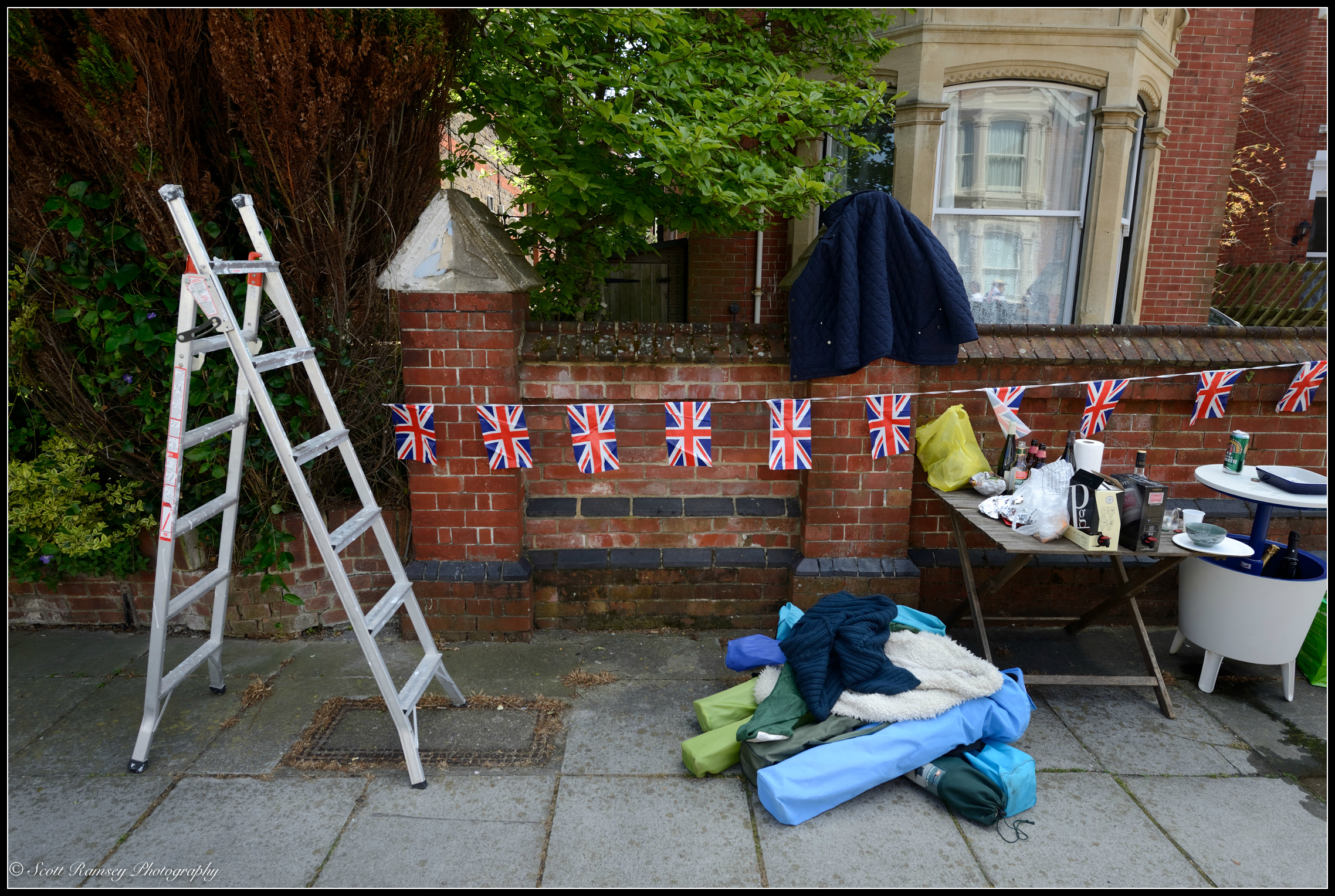 A step ladder, flags, table and chairs outside a housein  Nettlecombe Avenue in Southsea, Portsmouth during a VE Day70th  anniversarystreet party. © Scott Ramsey Photography.