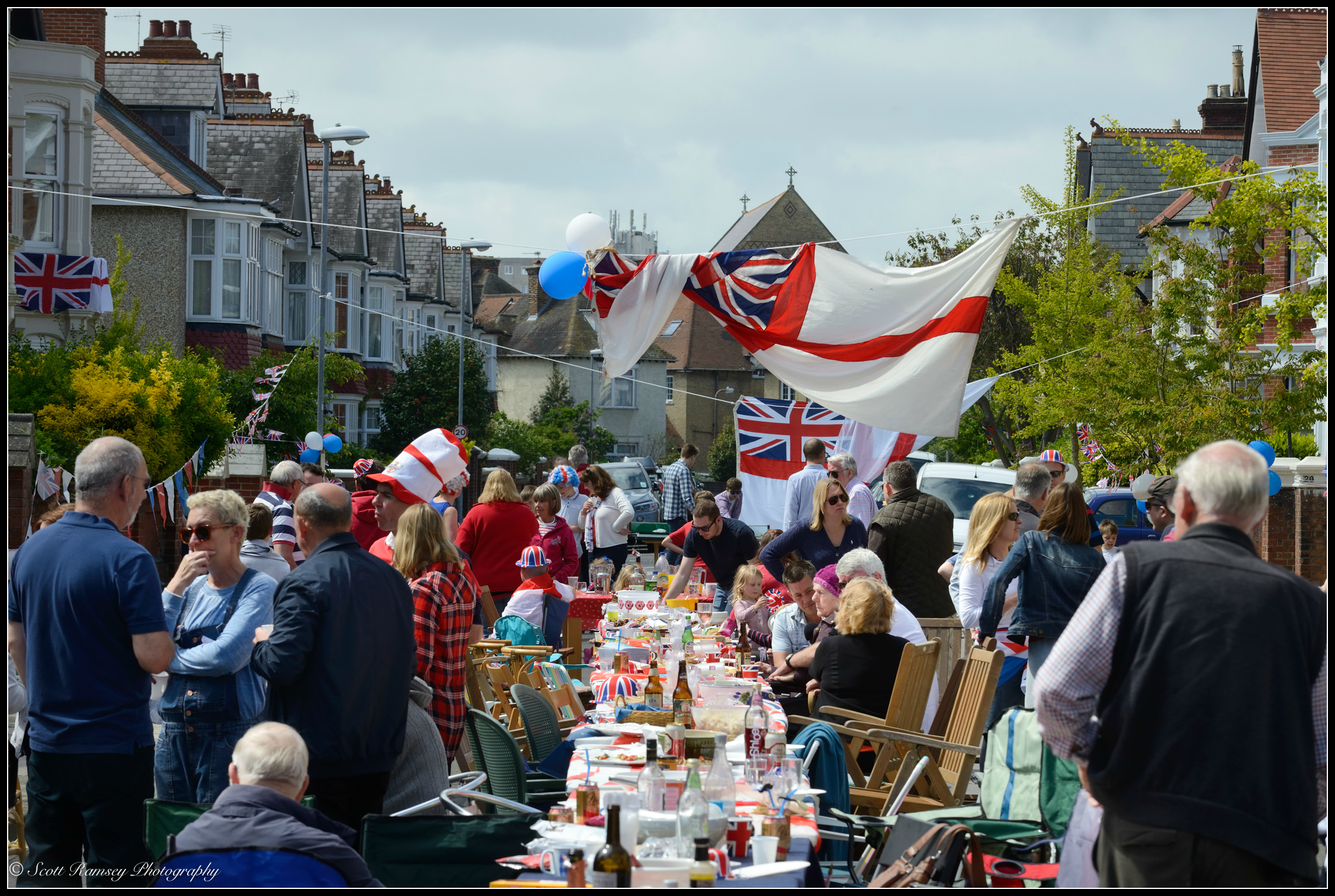 Residents set up tables and chairs and hold a streetparty outside their homes in Nettlecombe Avenue, Southsea, Portsmouth, UK during the VE Day 70th Anniversary. © Scott Ramsey Photography.